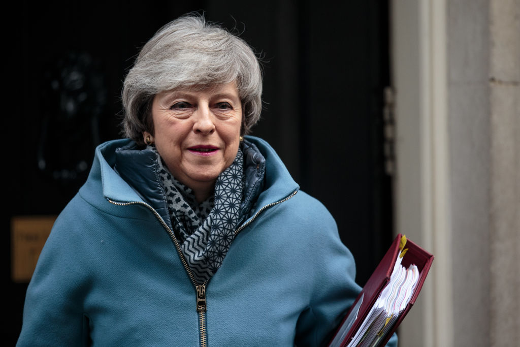 British Prime Minister Theresa May leaves Number 10 Downing Street for Prime Minister's Questions in Parliament on February 13, 2019 in London, England.