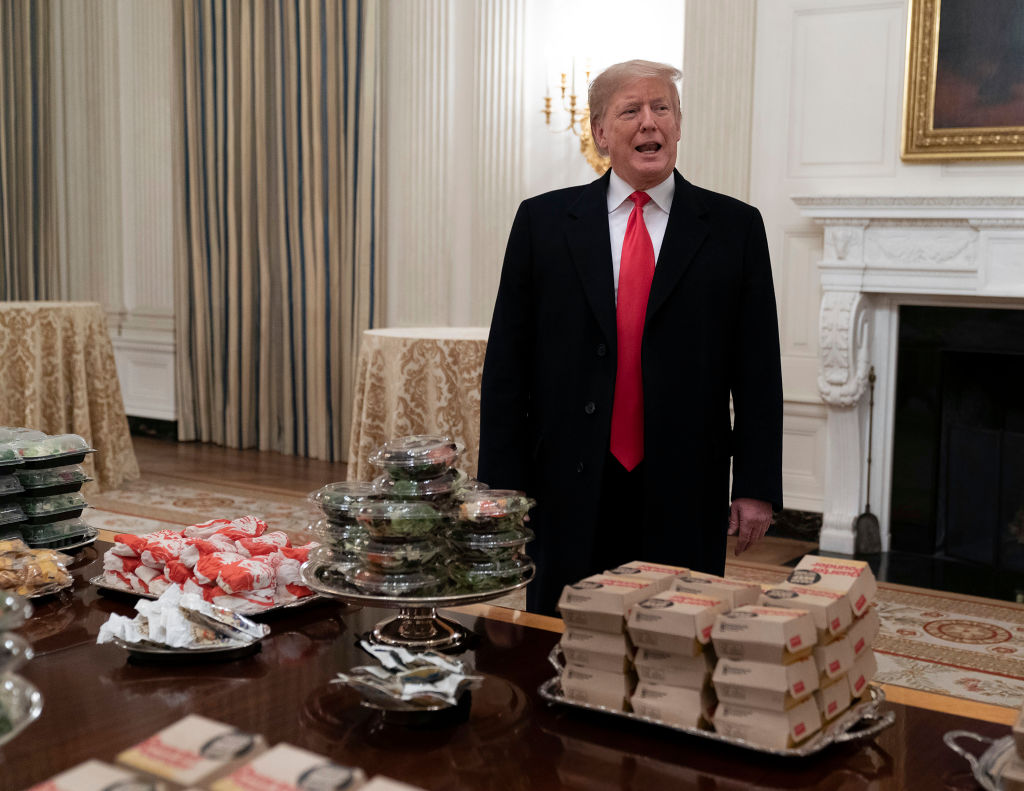 President Donald Trump presents fast food to the Clemson Tigers in celebration of their national championship at the White House on January 14, 2019 in Washington, DC. On Feb. 14, 2019, the results of his annual physical showed he has become technically obese.