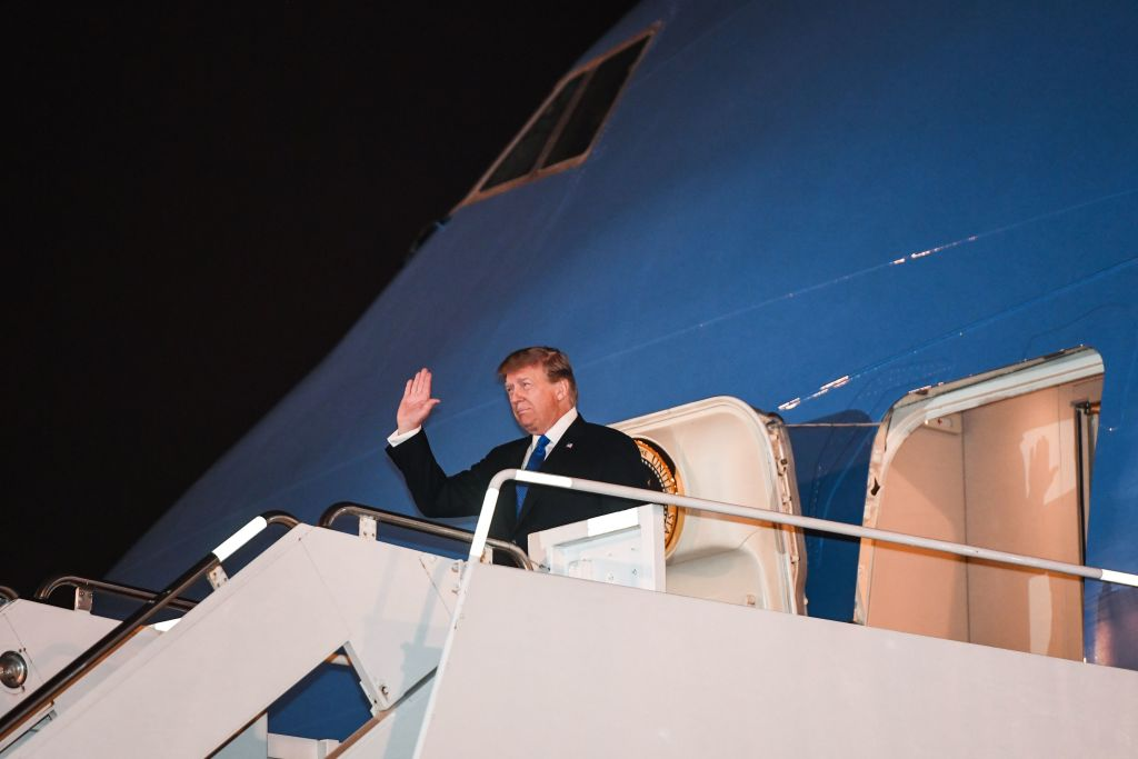 President Donald Trump waves as he disembarks from Air Force One at Noi Bai International Airport in Hanoi on Feb. 26, 2019, upon his arrival in Vietnam for a second summit with North Korean leader Kim Jong Un.