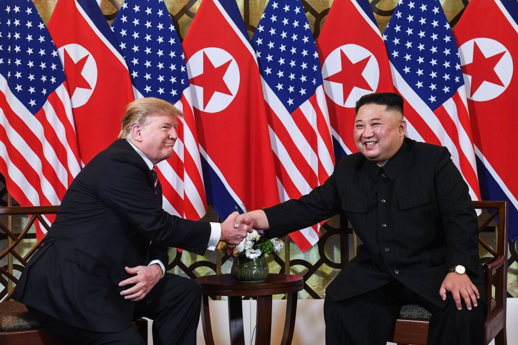 U.S. President Donald Trump shakes hands with North Korea's leader Kim Jong Un following a meeting at the Sofitel Legend Metropole hotel in Hanoi on February 27, 2019.