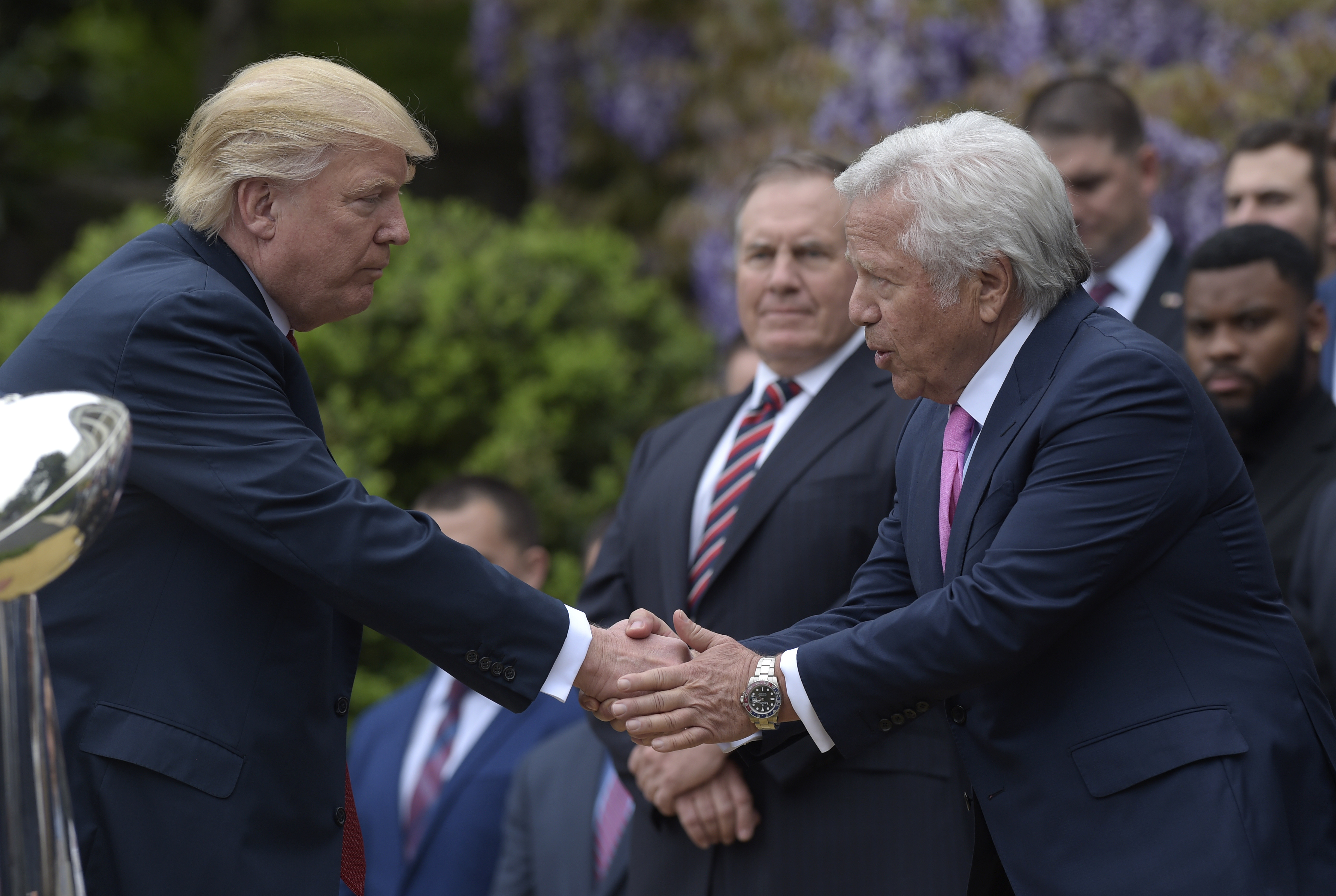President Donald Trump shakes hands with New England Patriots owner Robert Kraft during a ceremony on the South Lawn of the White House in Washington, DC on April 19, 2017, where the president honored the Super Bowl Champion New England Patriots for their Super Bowl LI victory.