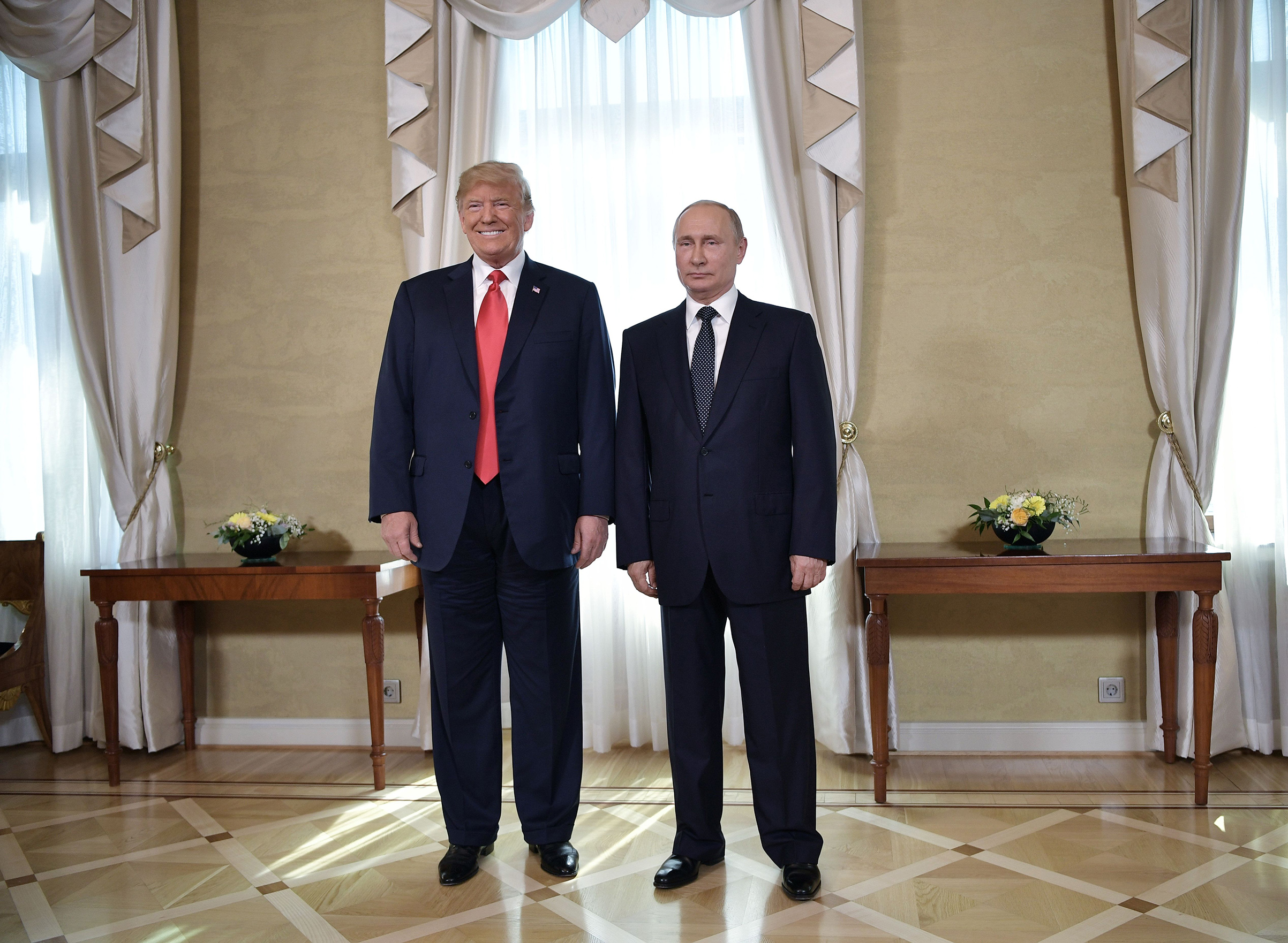US President Donald Trump and Russia's President Vladimir Putin pose ahead a meeting in Helsinki, on July 16, 2018.