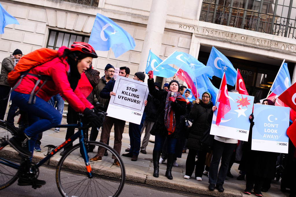 Activists protest the treatment of Uyghur Muslims by Chinese authorities in the East Turkestan region of China's Xinjiang province at a protest outside the Chinese embassy in London, England, on Feb. 2, 2019. On Feb. 9, 2019 Turkey demanded China close  concentration camps  holding the Muslim Uighur minority.