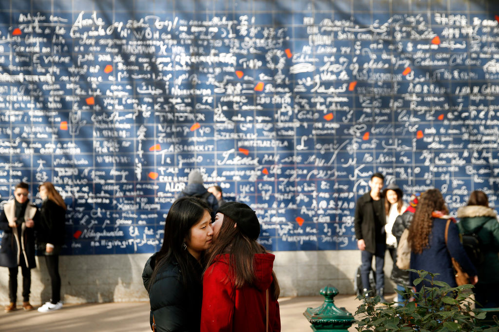A couple kiss in front of « The wall of I love you » (Le mur des je t'aime) on the eve of the Valentine's Day in Paris on Feb. 13, 2019.