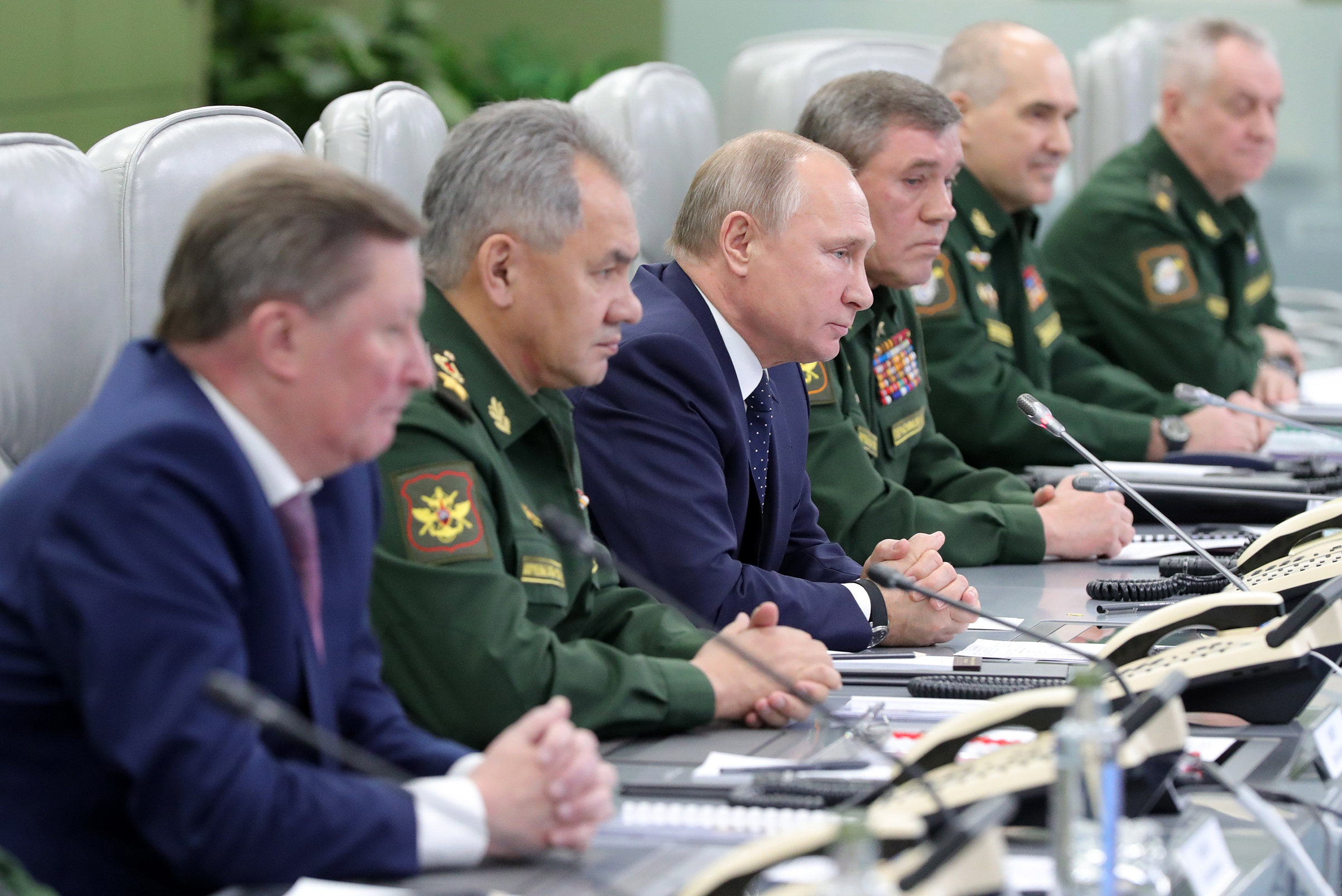 Vladimir Putin, center, watches the launch of a new Russian hypersonic missile system on Dec. 26