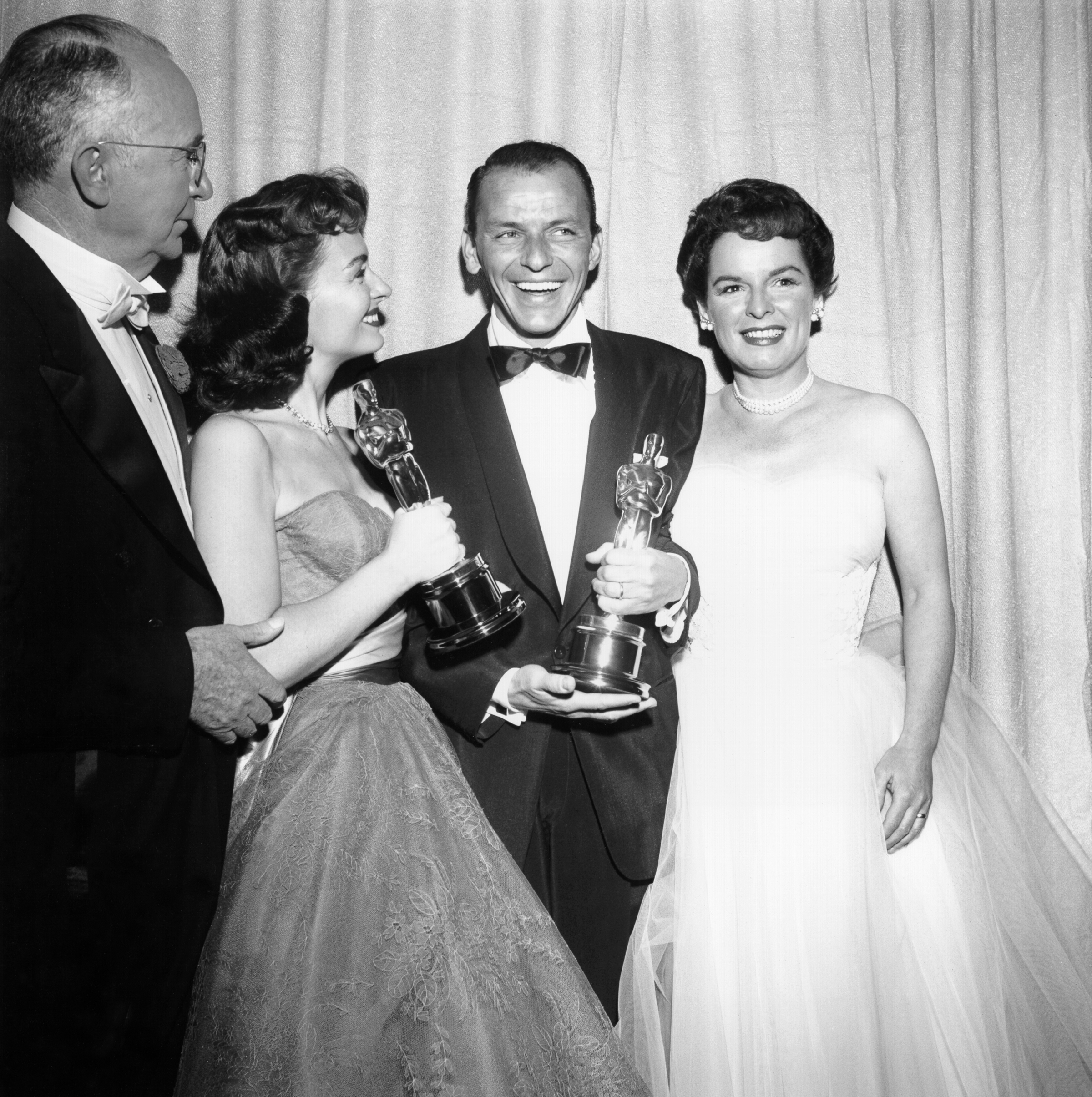 Movie stars Donna Reed and Frank Sinatra hold their Oscars which they won for Best Supporting Actress and Best Supporting Actor respectively in the movie  From Here To Eternity  as they pose with presenters Walter Brennan and Mercedes McCambridge backstage at the RKO Pantages Theatre on March 25, 1954 in Los Angeles, California.