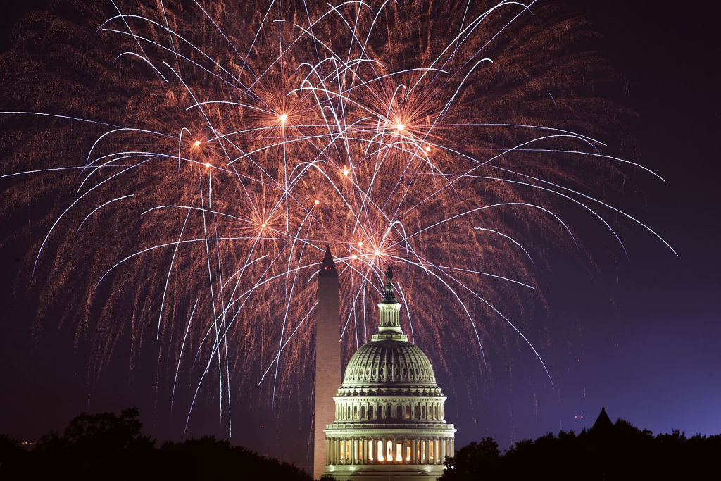 Fireworks explode overhead at the U.S. Capitol and the Washington Monument on Independence Day July 4, 2018 in Washington, DC.