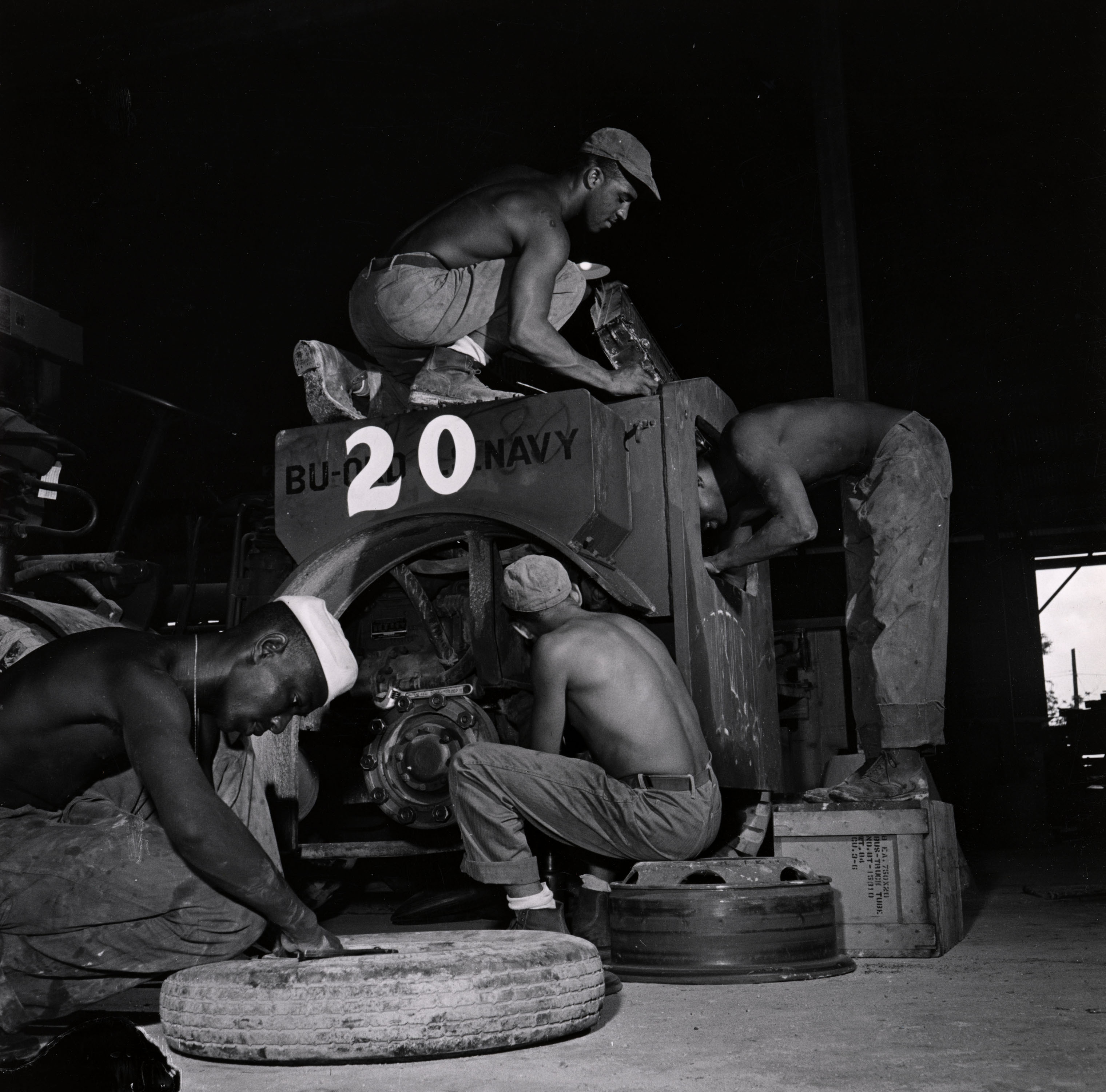 Sailors assigned to work as laborers at the US Naval Supply Depot on Guam.