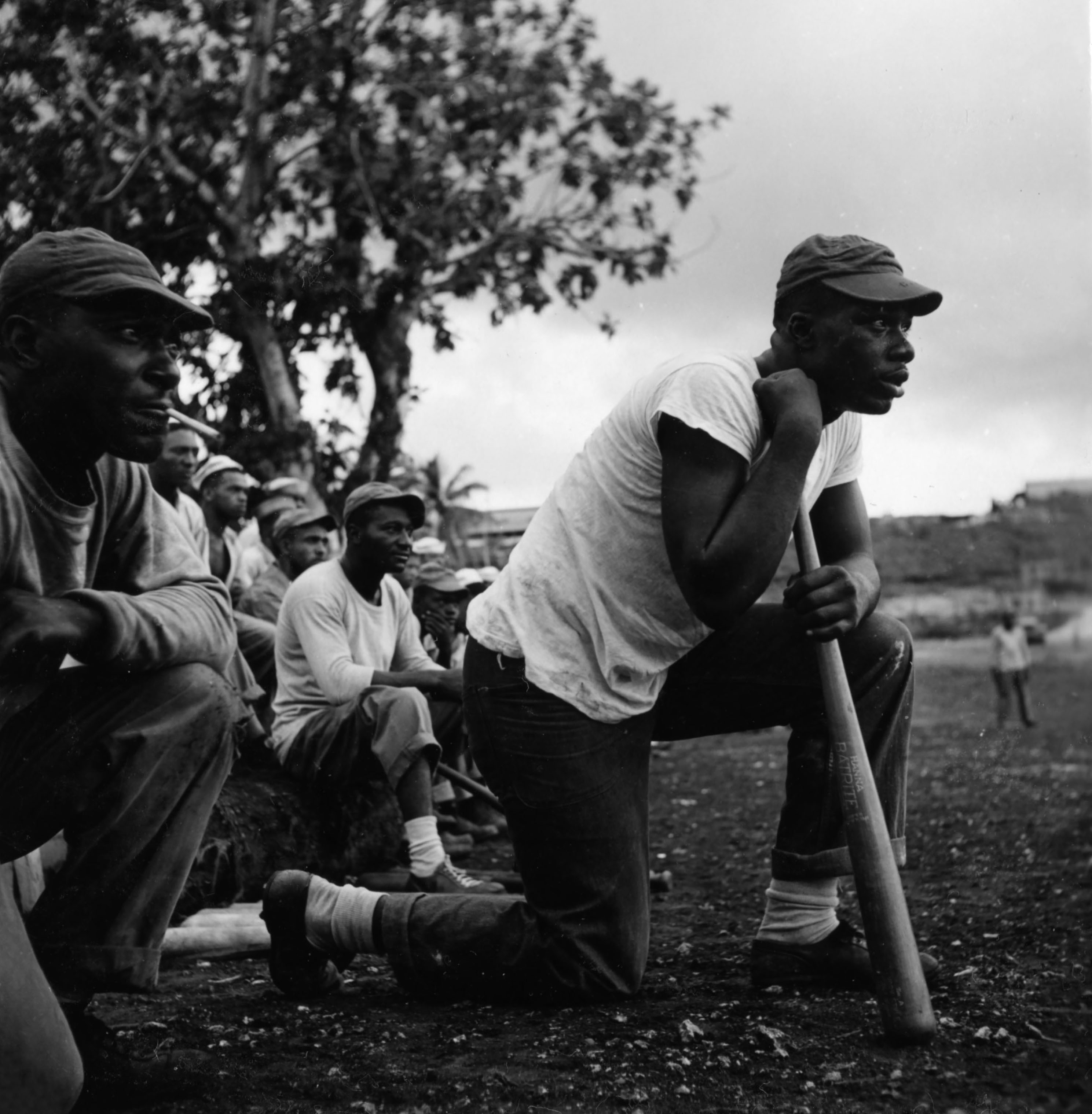 Sailors assigned to work as laborers at the U.S. Naval Supply Depot on Guam playing baseball.