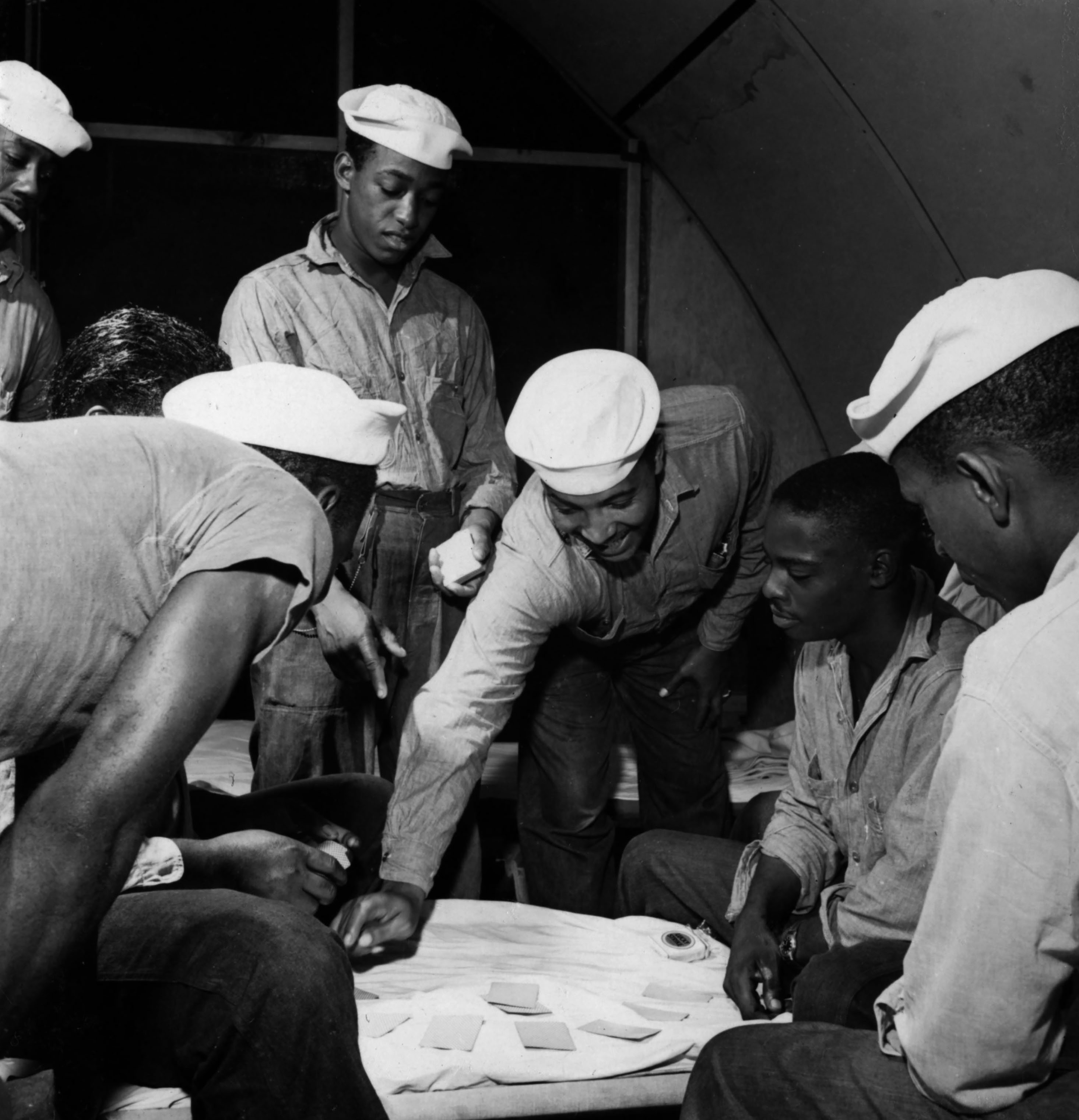 Sailors playing cards at the U.S. Naval Supply Depot on Guam.