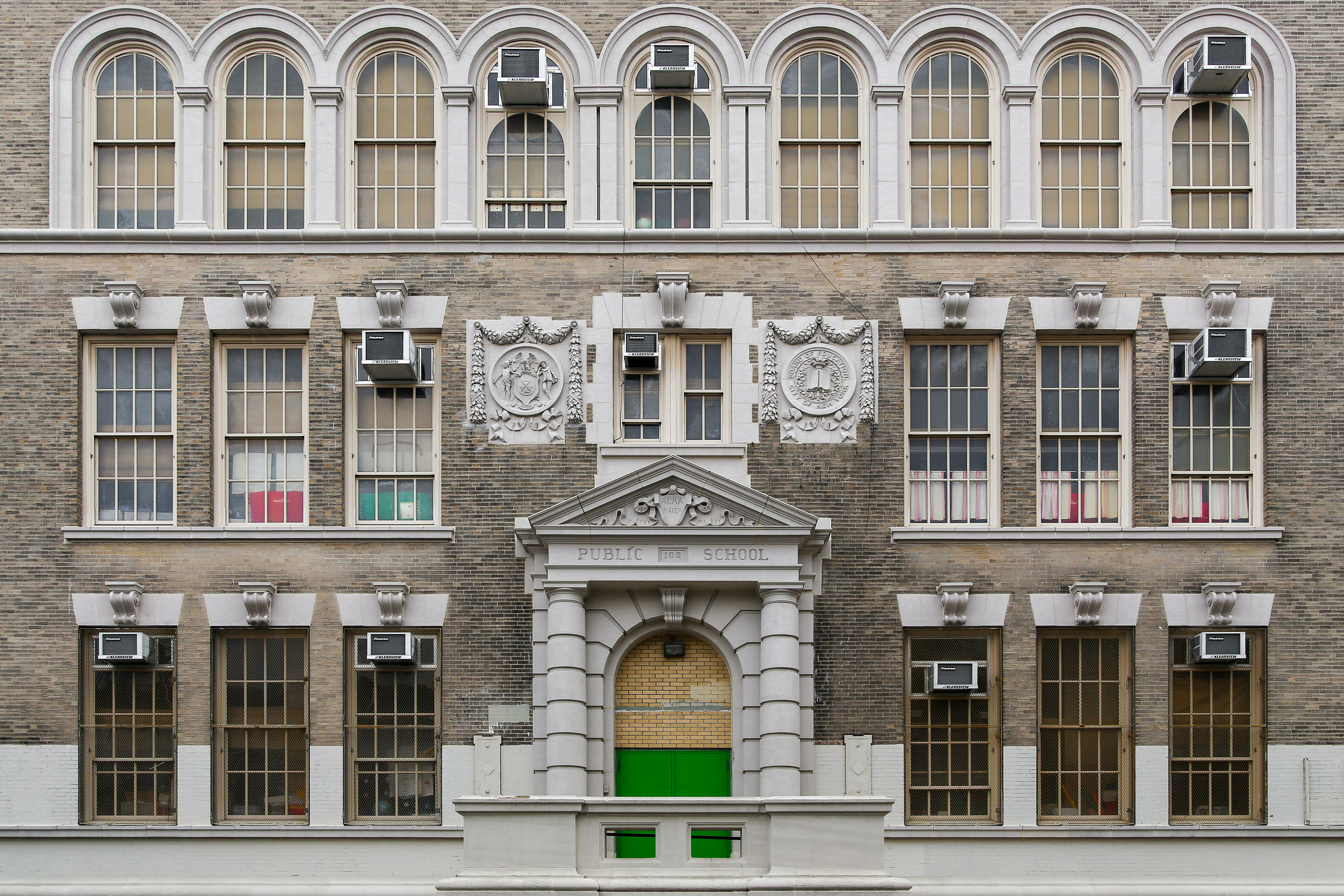 Historic brick building of Public school in Brooklyn, New York.