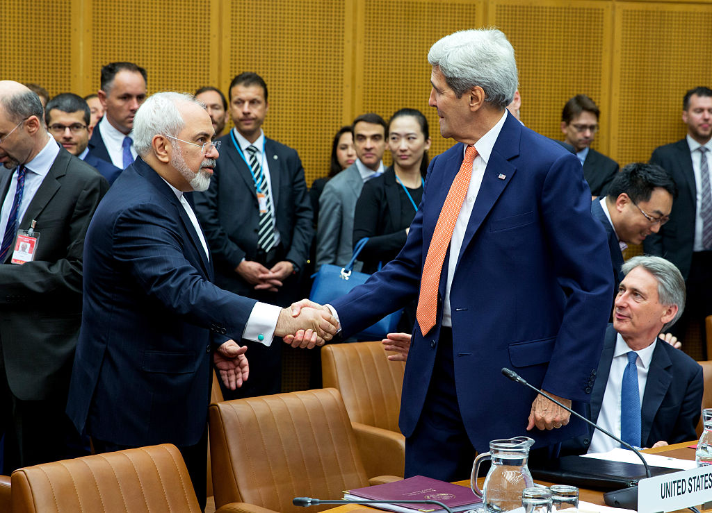 Foreign Minister of Iran, Mohammad Javad Zarif shakes hands with U.S. Secretary of State John Kerry at the last working session of E 3+3 negotiations on July 14, 2015 in Vienna, Austria.
