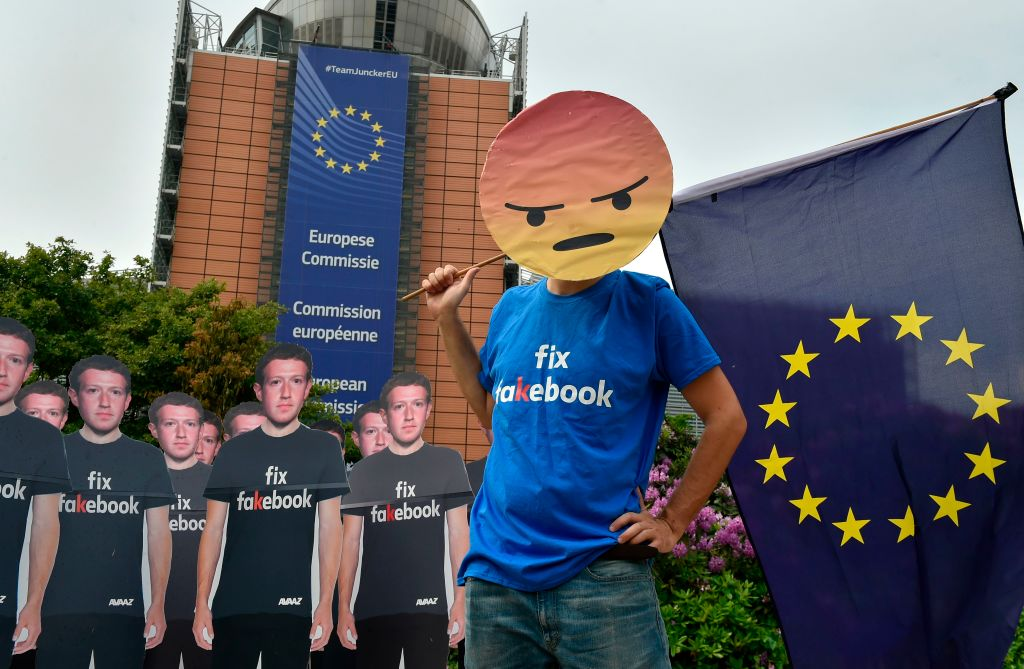 Global activists from Avaaz set up cardboard cutouts of Facebook chief Mark Zuckerberg, bearing the words   Fix Fakebook,  in front of the European Union headquarters in Brussels, on May 22, 2018.