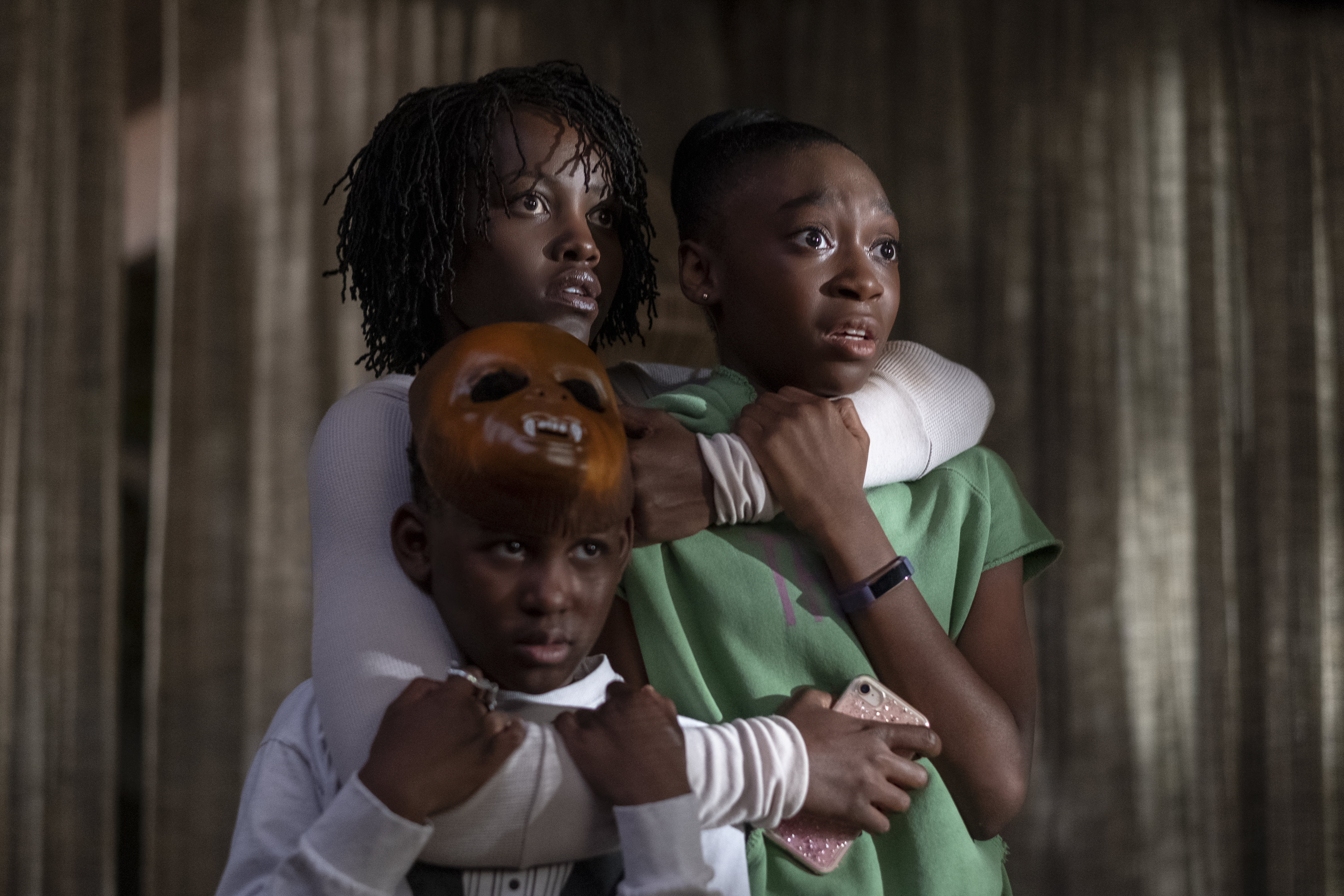 Clockwise from top left, Lupita Nyong'o, Shahadi Wright Joseph and Evan Alex in  Us.