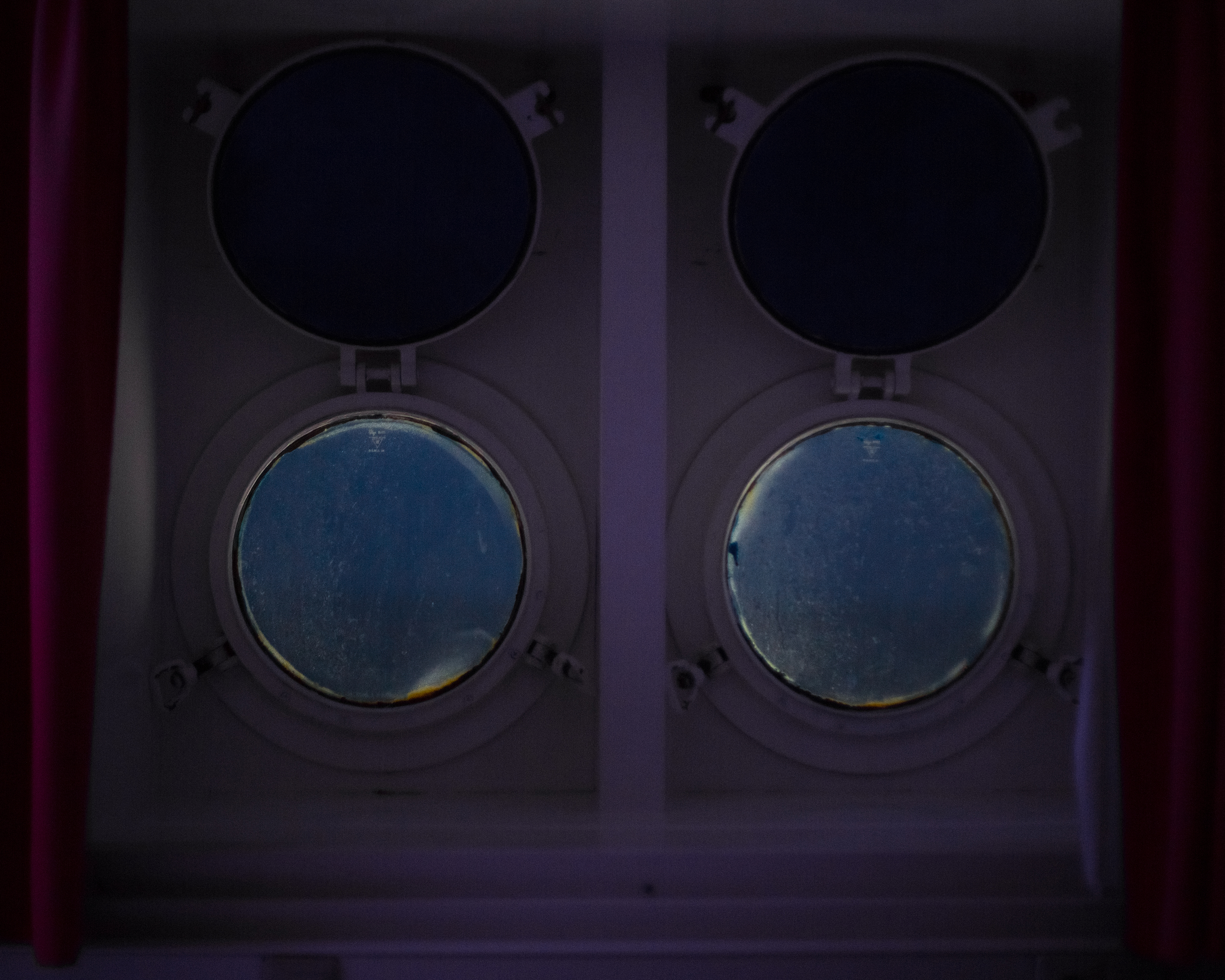 The Drake Passage, the notorious body of water separating Argentina and the Antarctic Peninsula, looms outside the portholes of a cabin. For guides who work long seasons in Antarctica, the turmoil of the Drake is a regular occurrence - a staff member may cross these waters up to 20 times in the course of a single Antarctic summer.