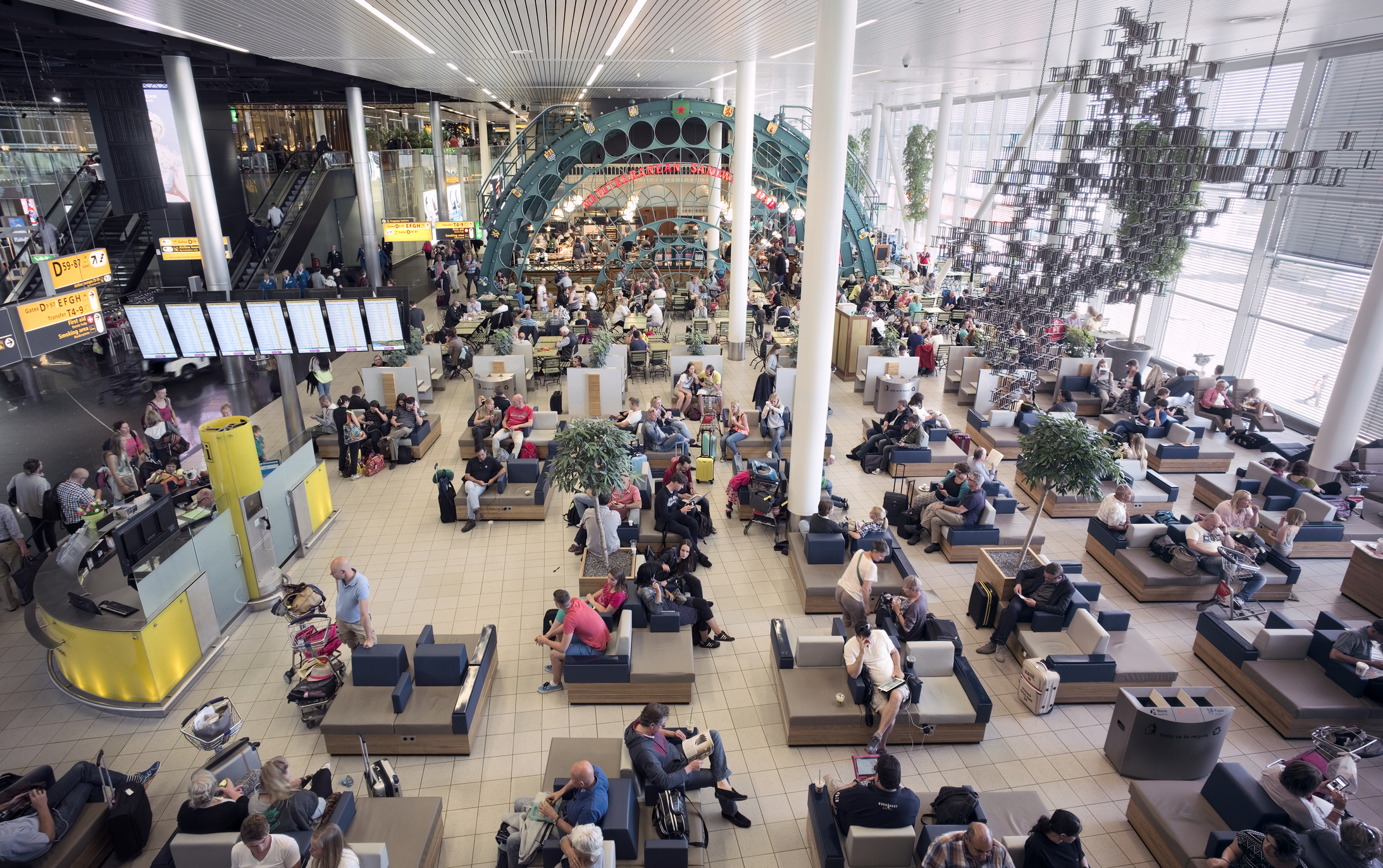 Travelers waiting for departure at one of the lounges (Schengen area) at Schiphol Airport, Amsterdam, The Netherlands.
