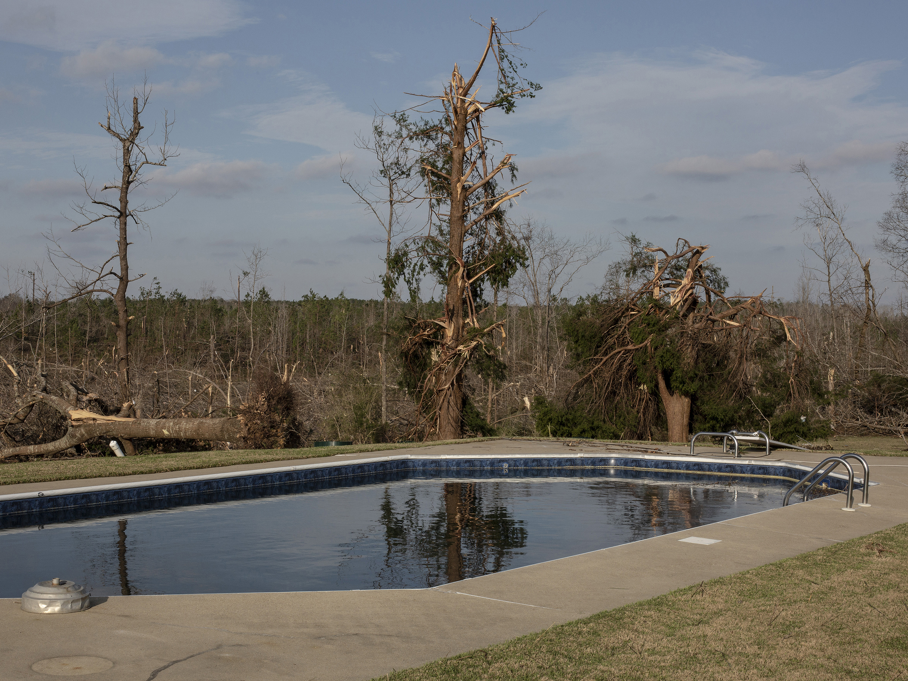 A swimming pool after a tornado passed over killing several people and destroying homes in Beauregard, Alabama, on March 4, 2019.