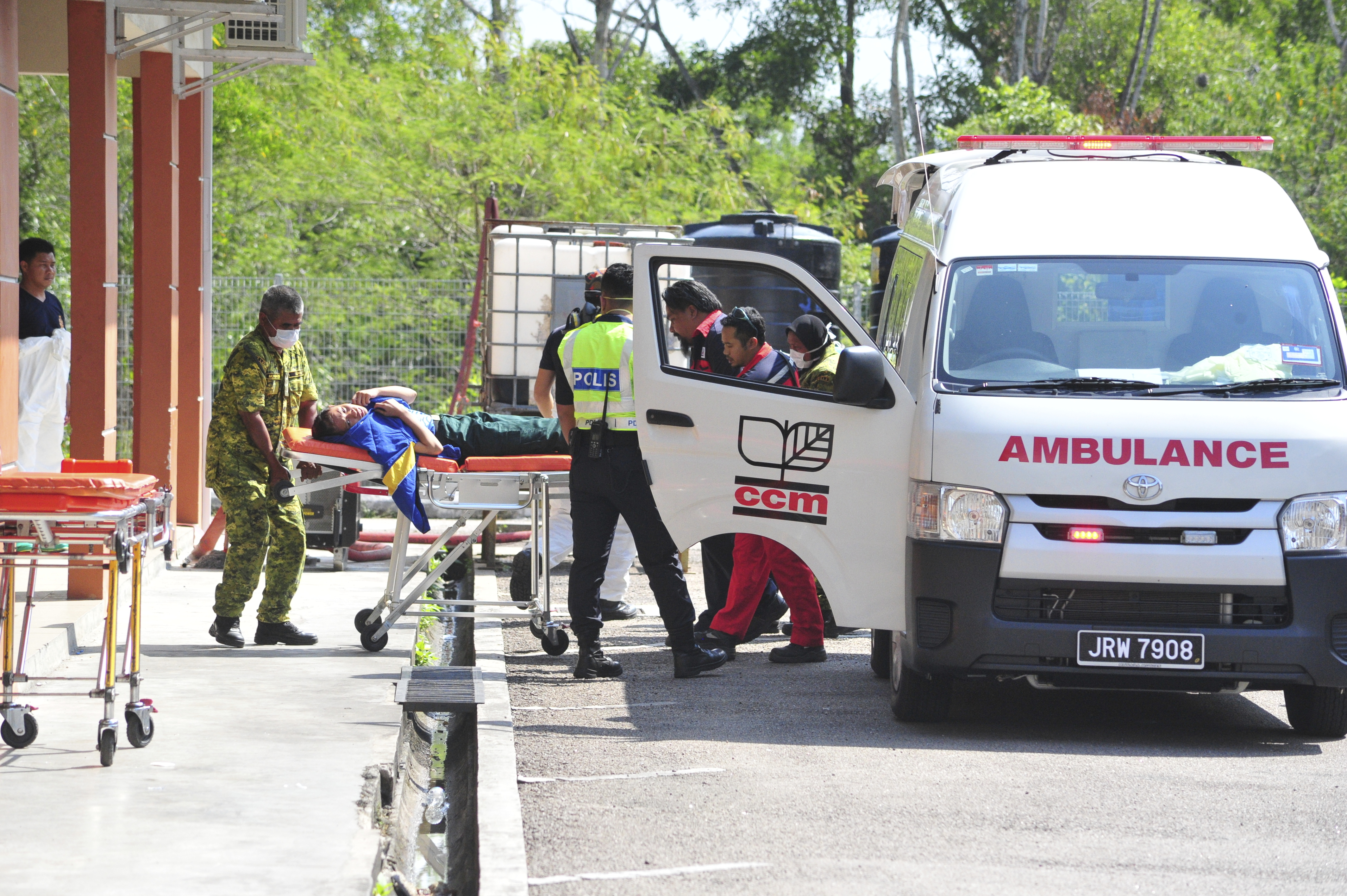Emergency personnel unload a student from an ambulance after toxic chemical spill in Pasir Gudang, Johor state on Mar. 13, 2019.