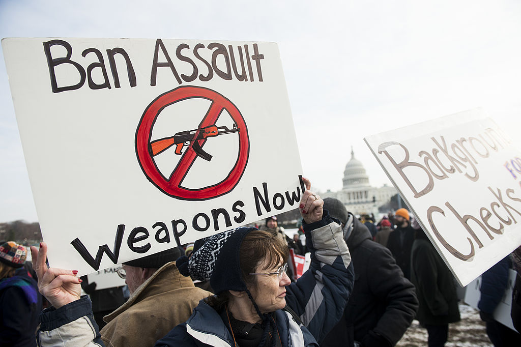 Gun reform supporters march from the U.S. Capitol to the Washington Monument to call on Congress to pass gun restriction measures on Jan. 26, 2013 in Washington, D.C.