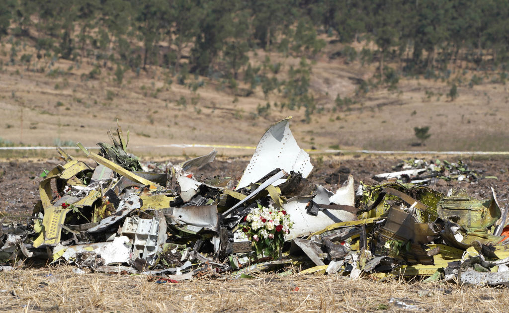 A bouquet of flowers is placed in front of a pile of debris at the scene of the Ethiopian Airlines Flight 302 crash where 157 passengers and crew perished on March 13, 2019 in Ejere, Ethiopia. French civil aviation safety agency BEA has begun to work on the cockpit voice recorder on March 16, 2019 from the crash.