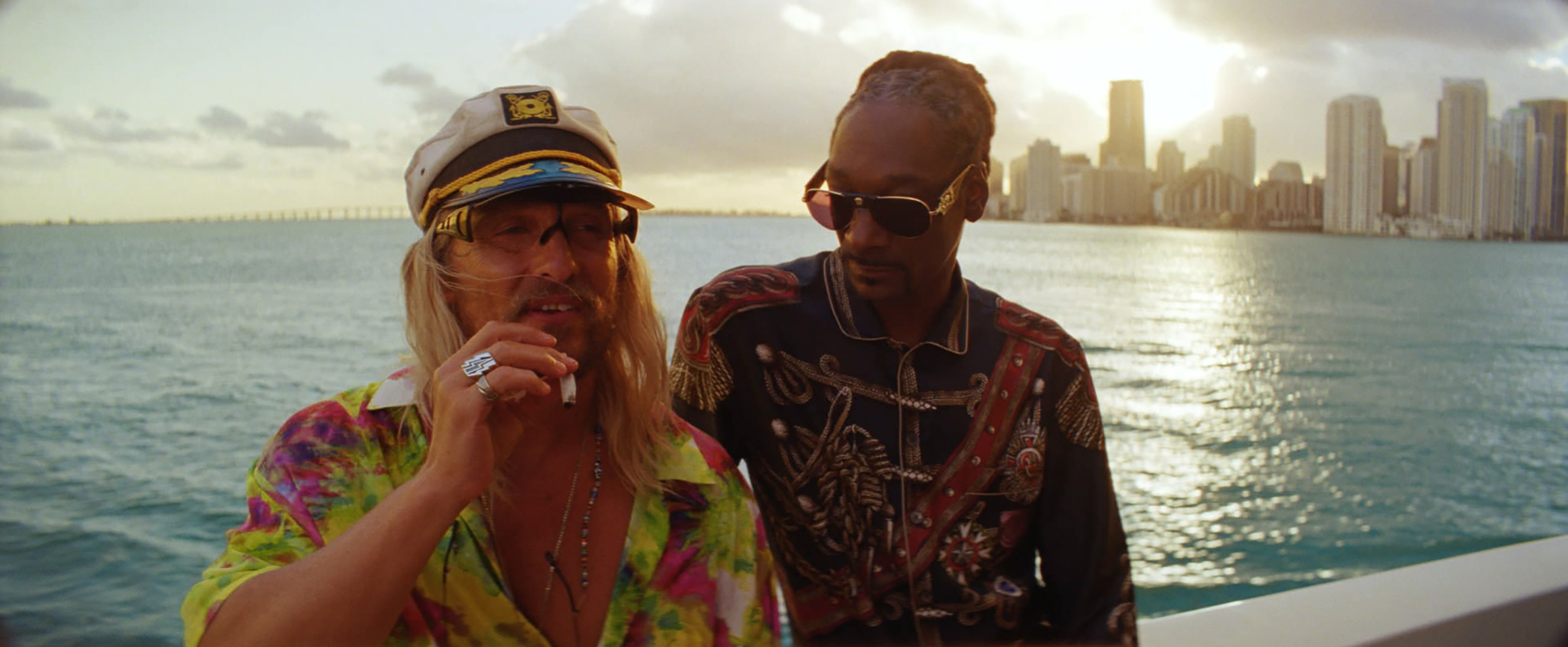 McConaughey mugs with rapper friend Lingerie, played by none other than Snoop Dogg
