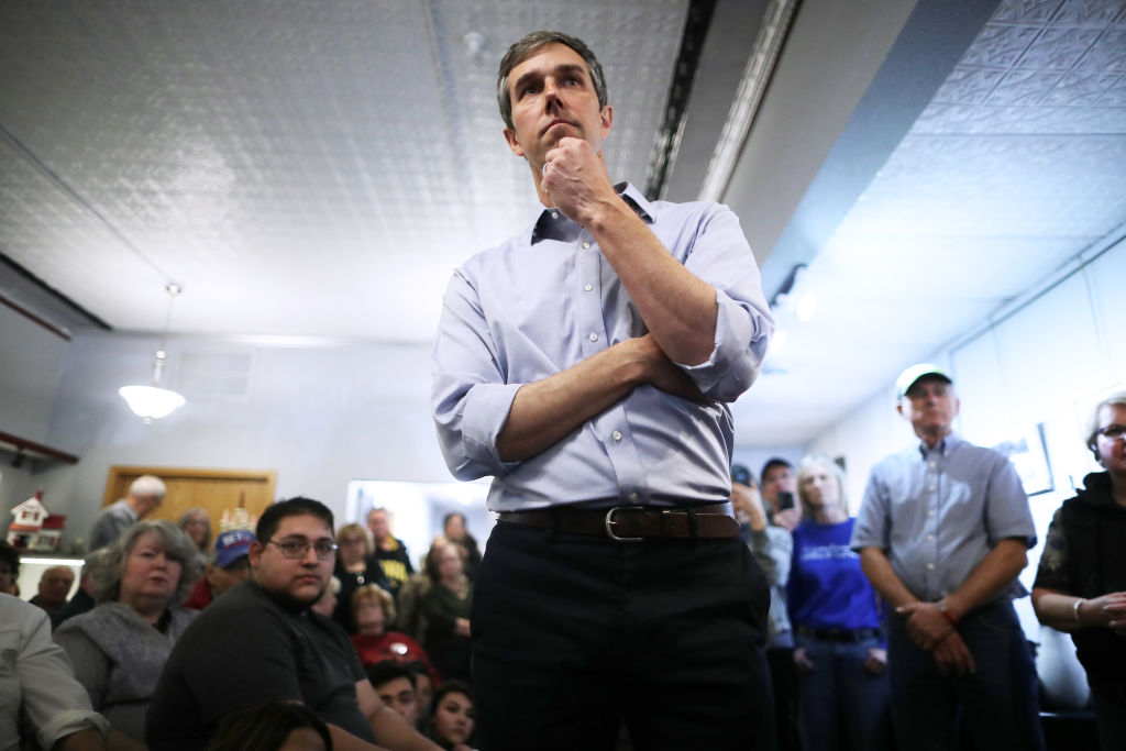 Democratic presidential candidate Beto O'Rourke talks with voters during his second day of campaigning for the 2020 nomination at Art Domestique March 15, 2019 in Washington, Iowa.