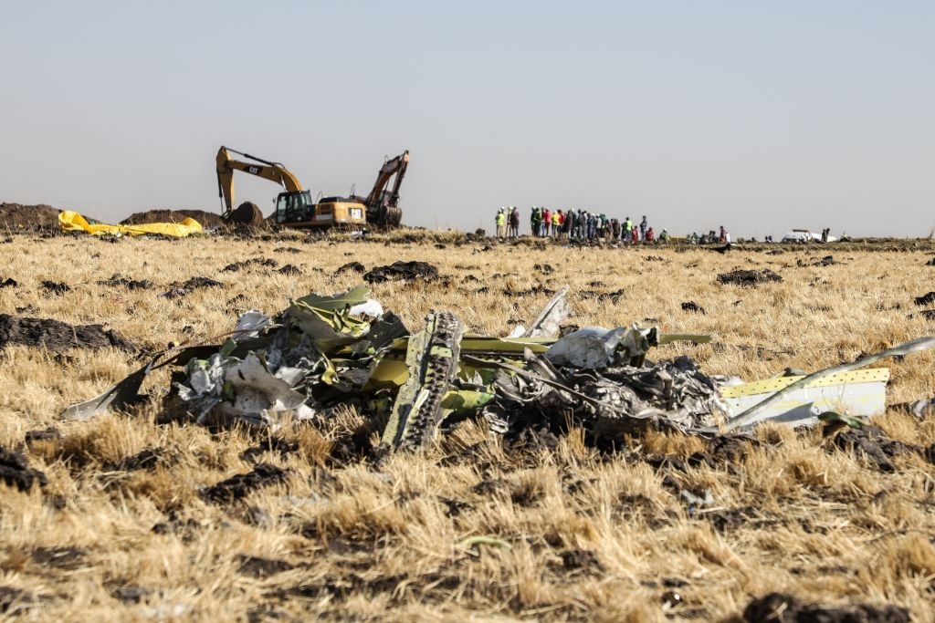 A power shovel digs next to debris at the crash site of Ethiopia Airlines near Bishoftu, a town some 60 kilometres southeast of Addis Ababa, Ethiopia, on March 11, 2019. An Ethiopian Airlines Boeing 737 crashed on March 10 morning en route from Addis Ababa to Nairobi with 149 passengers and eight crew believed to be on board, Ethiopian Airlines said.