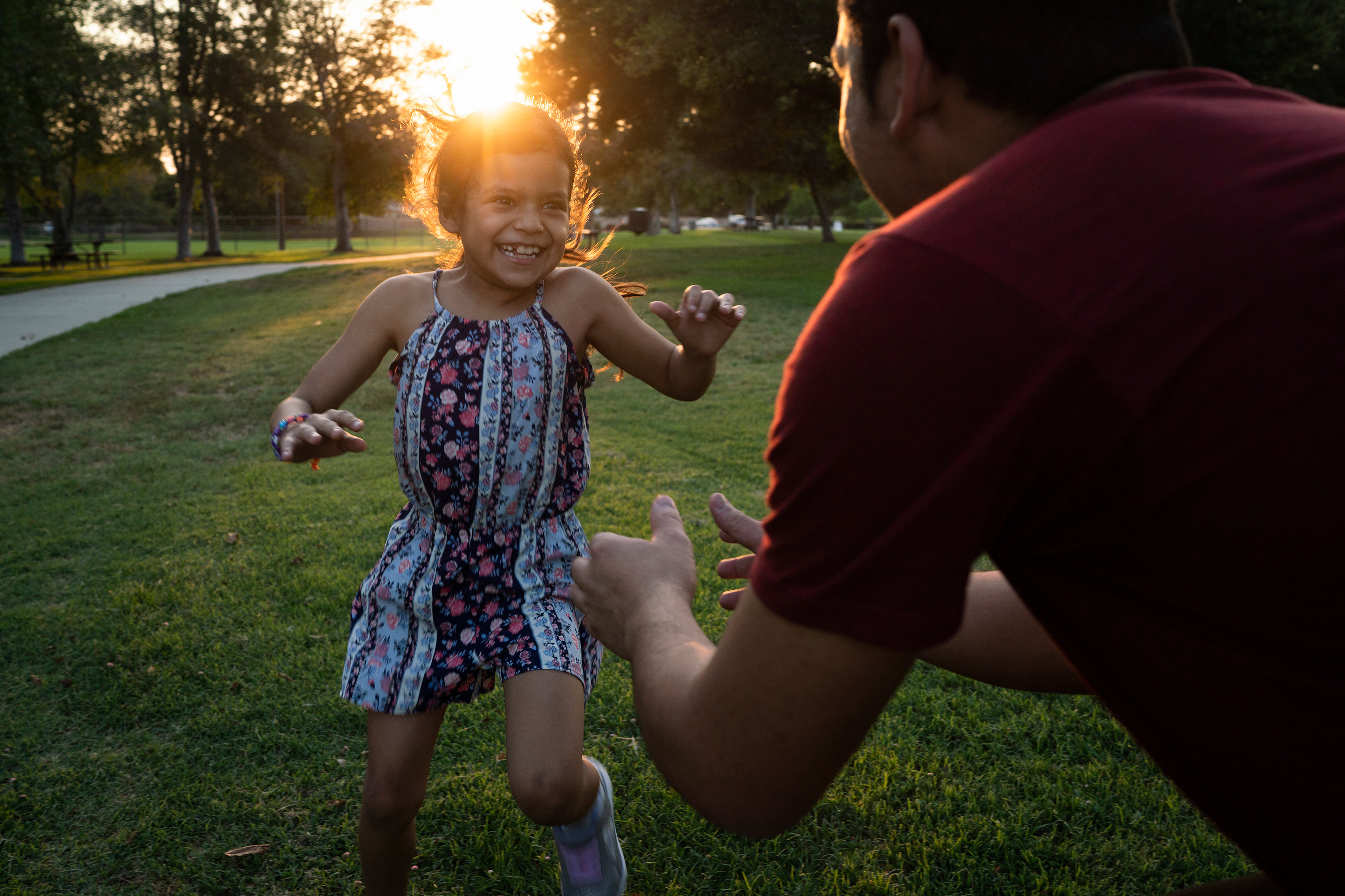 Heyli and her father play together at a park near their temporary home in Southern California.