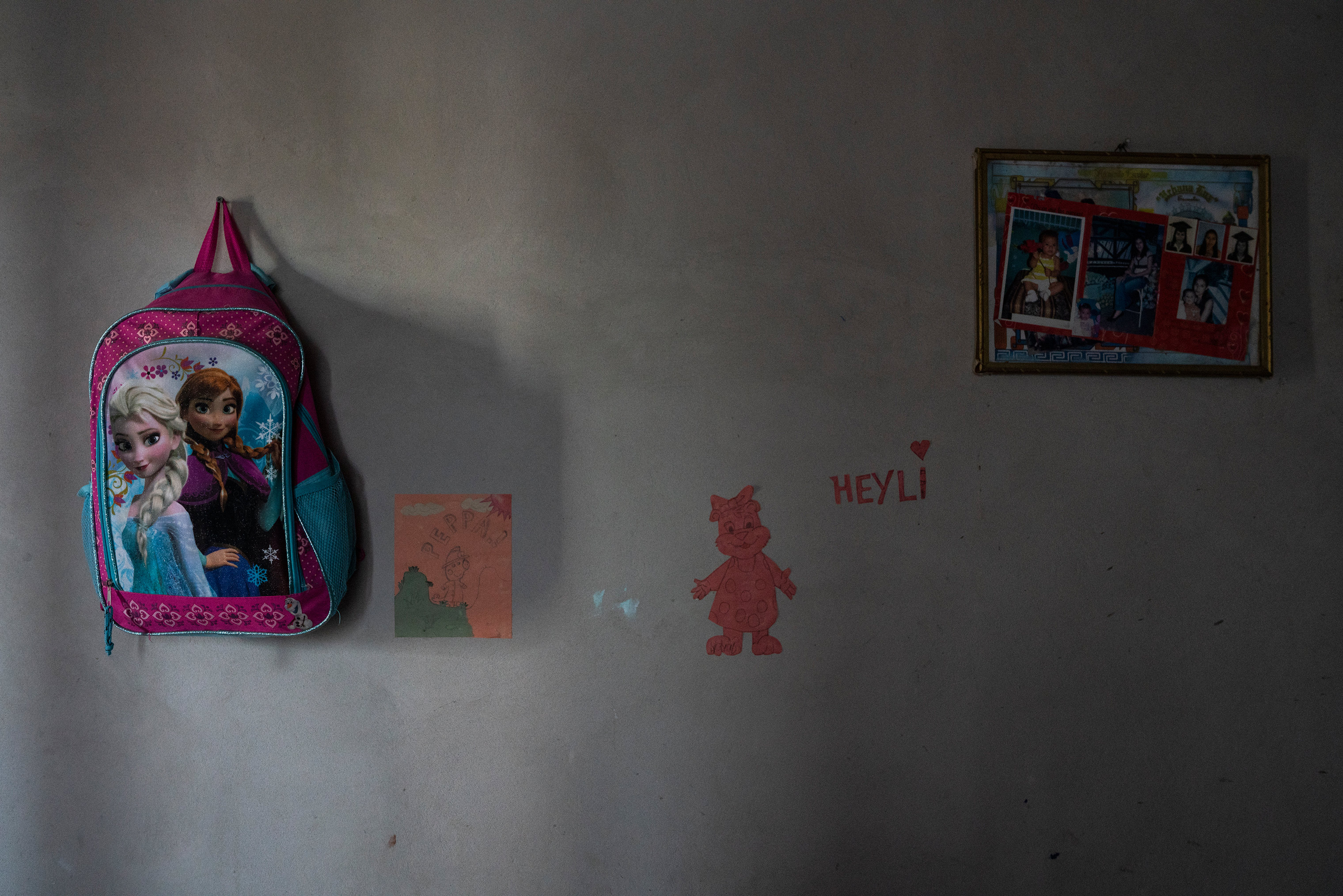 Belongings that Heyli, left behind hang on a wall in a house her parents leased in Olancho, Honduras.