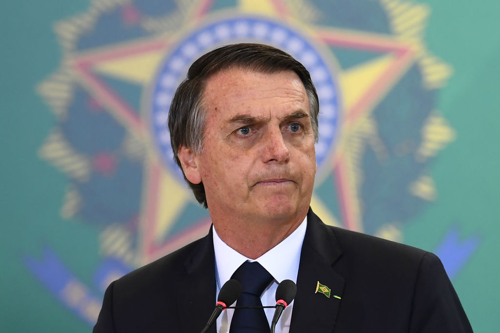 Brazilian President Jair Bolsonaro delivers a speech during the appointment ceremony of the new heads of public banks, at Planalto Palace in Brasilia on Jan. 7, 2019. Brazil's conservative new president tweeted a lewd Carnival scene on Mar. 6, 2019 of people peeing on each other that has gone viral.