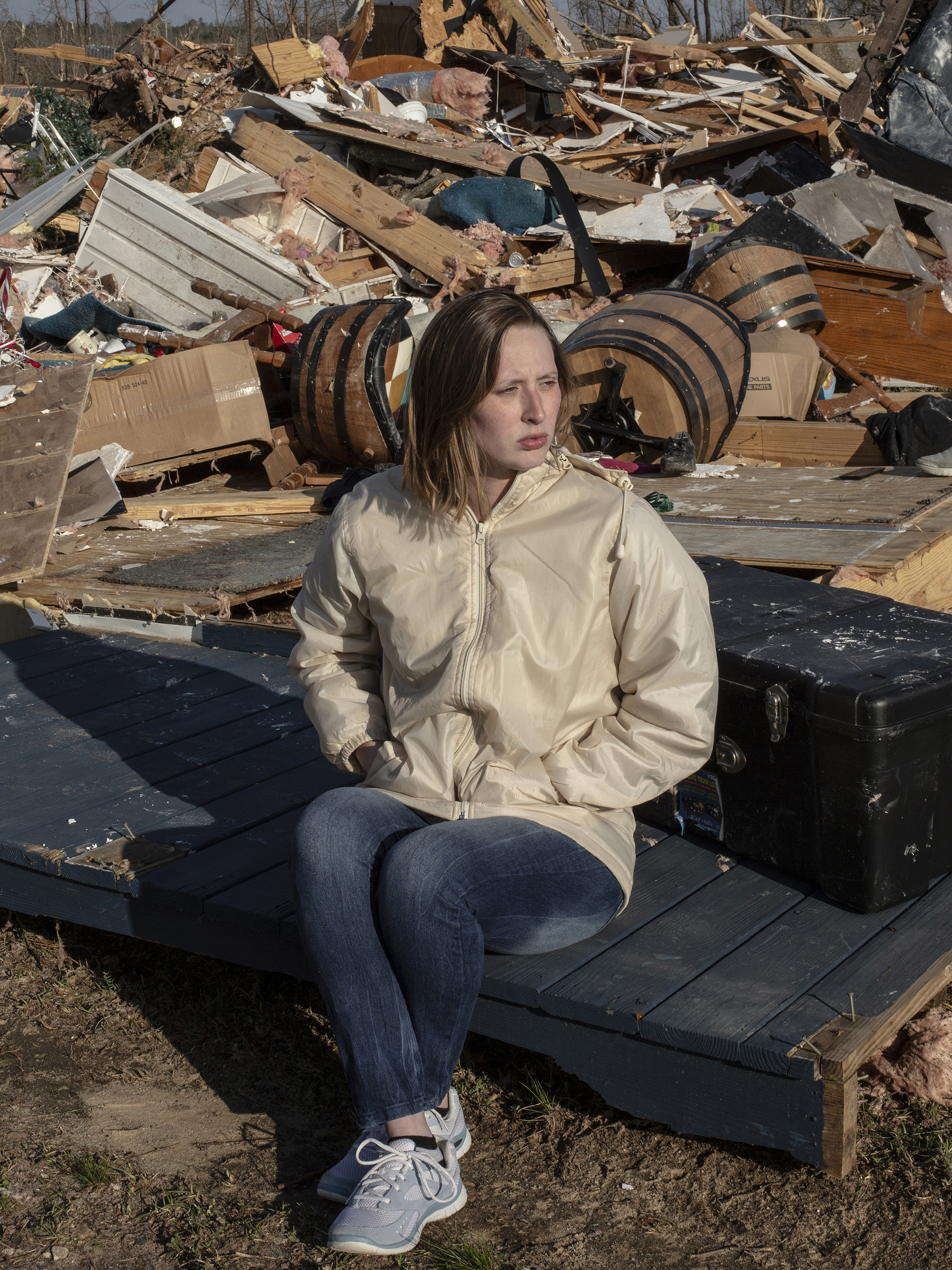 Jessica Chandler poses for a portrait in her neighborhood, which was destroyed after a tornado passed over killing 23 people and destroying homes in Beauregard, Alabama on March 4, 2019.