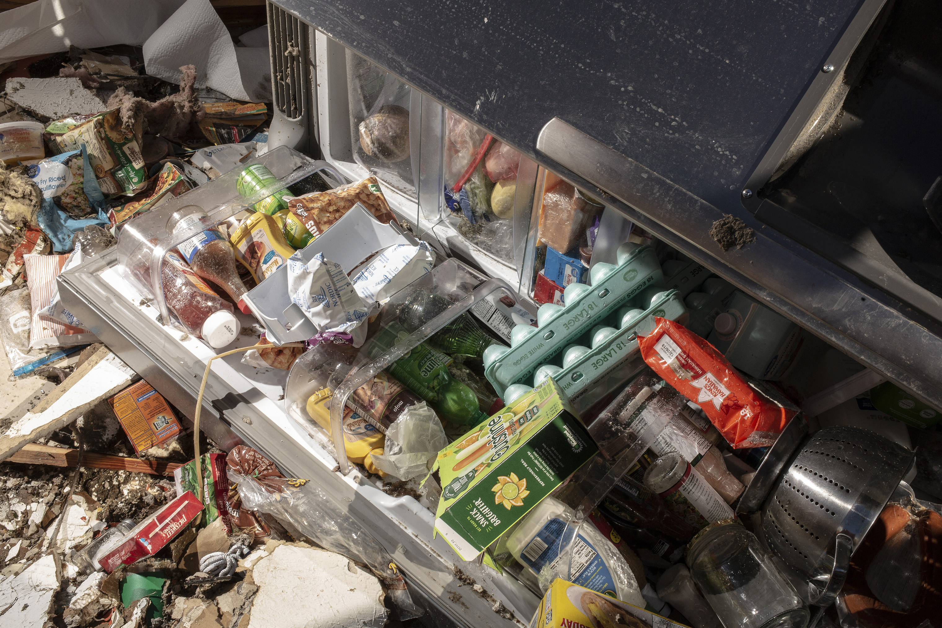 The contents of the Mattocks' refrigerator strewn on their kitchen floor after a tornado passed over killing several people and destroying homes in Beauregard, Alabama on March 4, 2019.