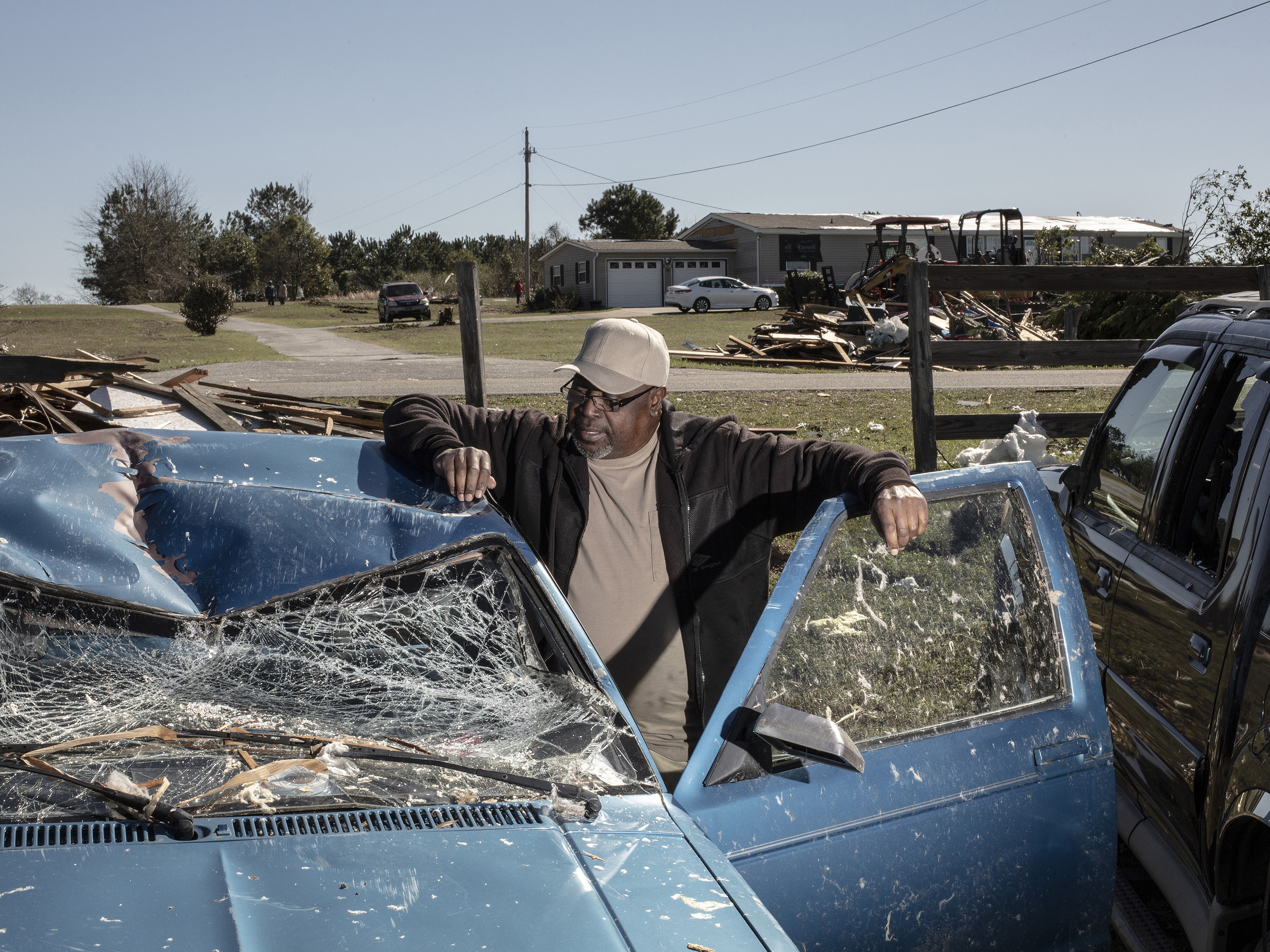Jimmie Tables poses for a portrait with his truck that was destroyed after a tornado passed over killing several people and destroying homes in Beauregard, Alabama on March 4, 2019.