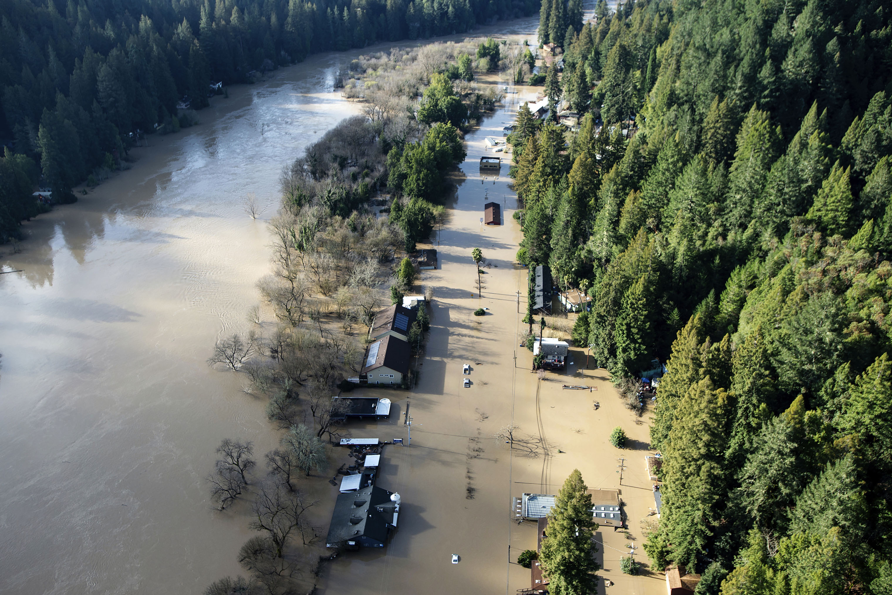 Flood waters from the Russian River partially submerge properties in Guerneville, Calif., on Feb. 28, 2019. The river in the wine country north of San Francisco reached its highest level in 25 years Wednesday night.