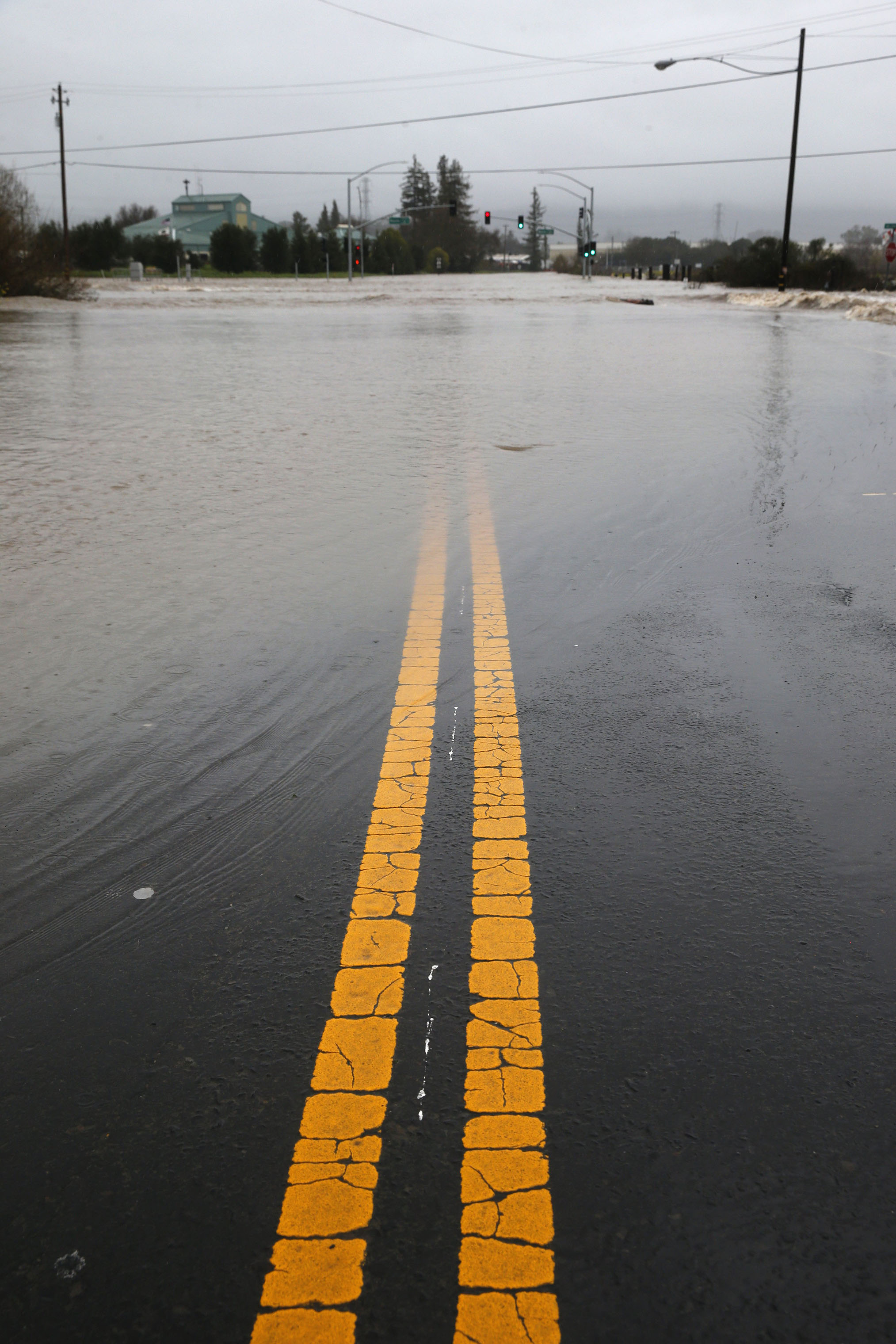 The intersection of Highways 121 and 12 are closed to traffic after the Sonoma Creek surged over its banks and flooded the roadway during the heavy rainstorm in Sonoma, California on Feb. 26, 2019.