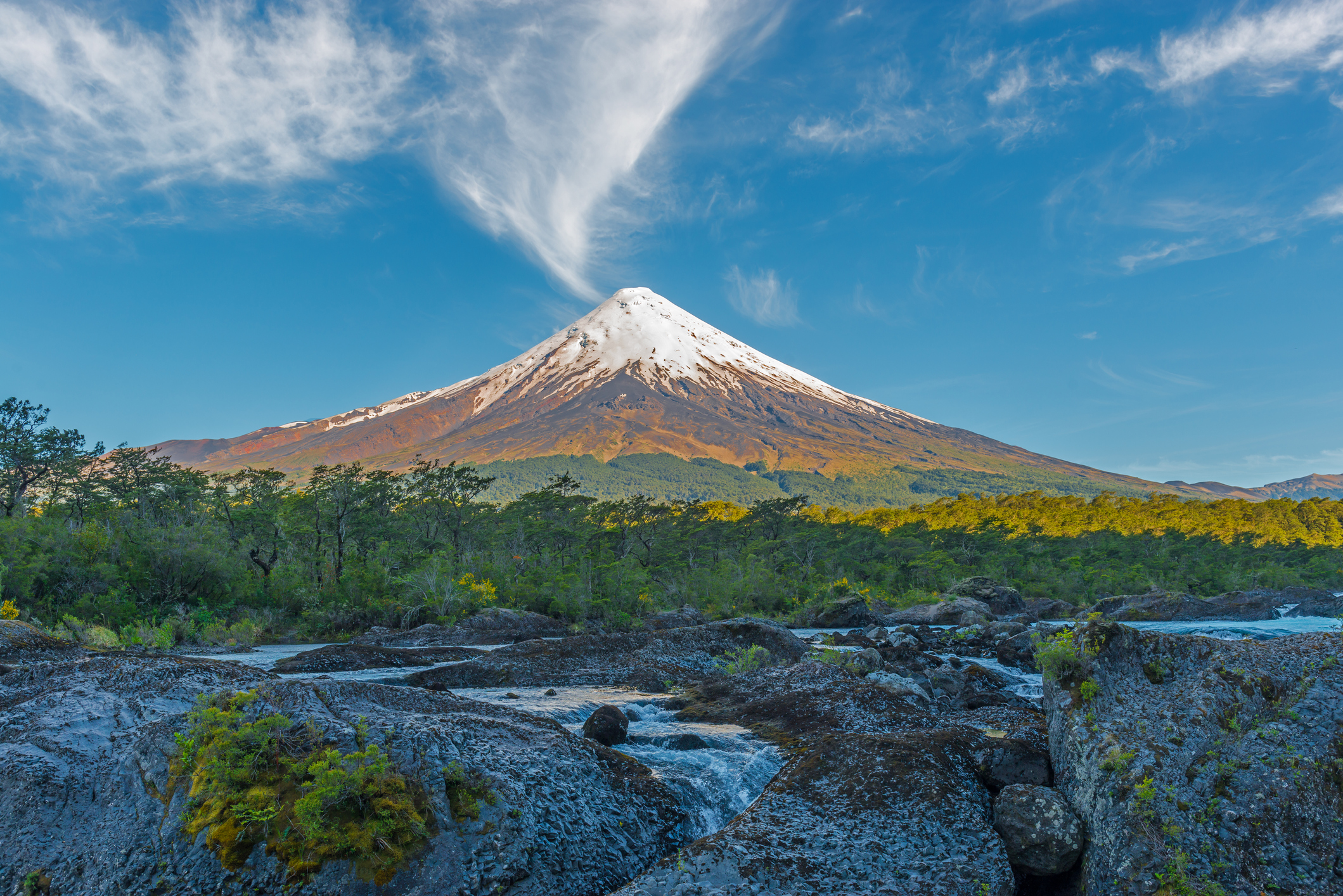 Osorno volcano with the Petrohue waterfalls and river in the foreground in the lake district near Puerto Varas and Puerto Montt, South Chile