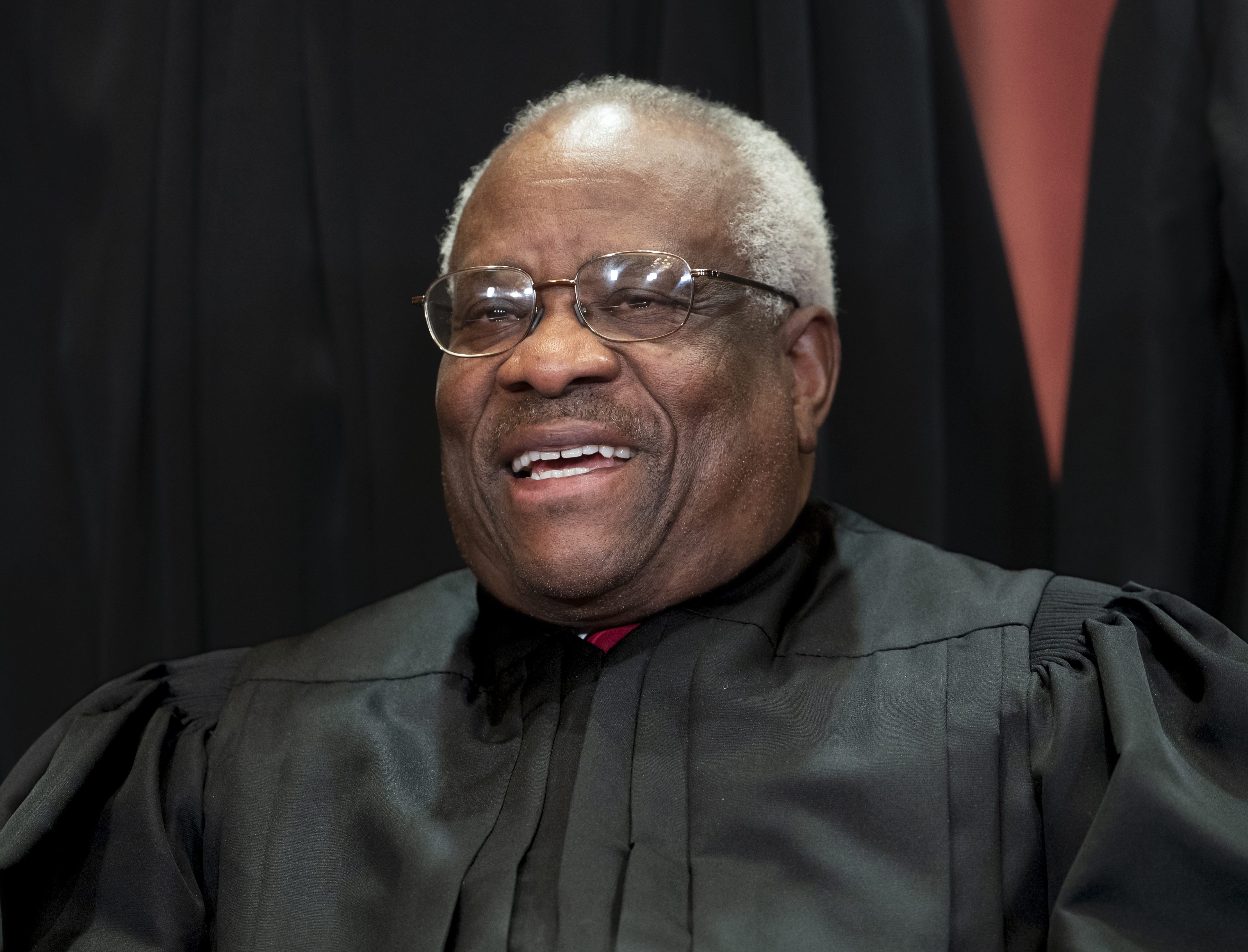 Associate Justice Clarence Thomas sits with fellow Supreme Court justices for a group portrait at the Supreme Court Building in Washington on Nov. 30, 2018. Thomas spoke at a U.S. Supreme Court argument for the first time in three years on March 20, 2019.