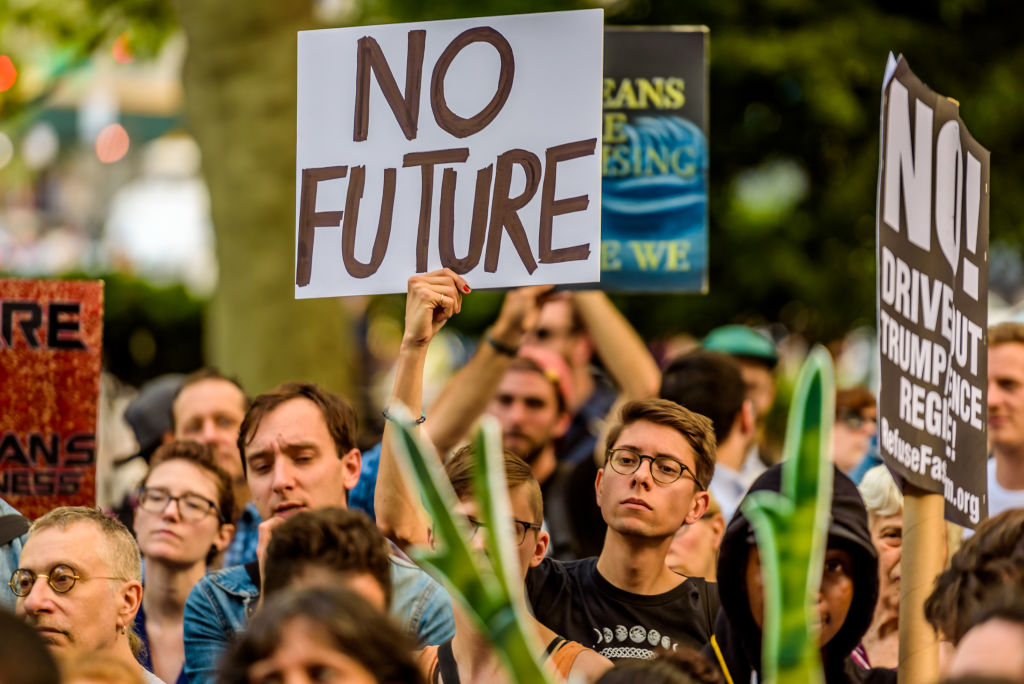 ctivist groups and concerned citizens held a rally at Foley Square and then marched to New York City Hall in protest of Trumps attack on the Paris climate agreement on June 1, 2017.