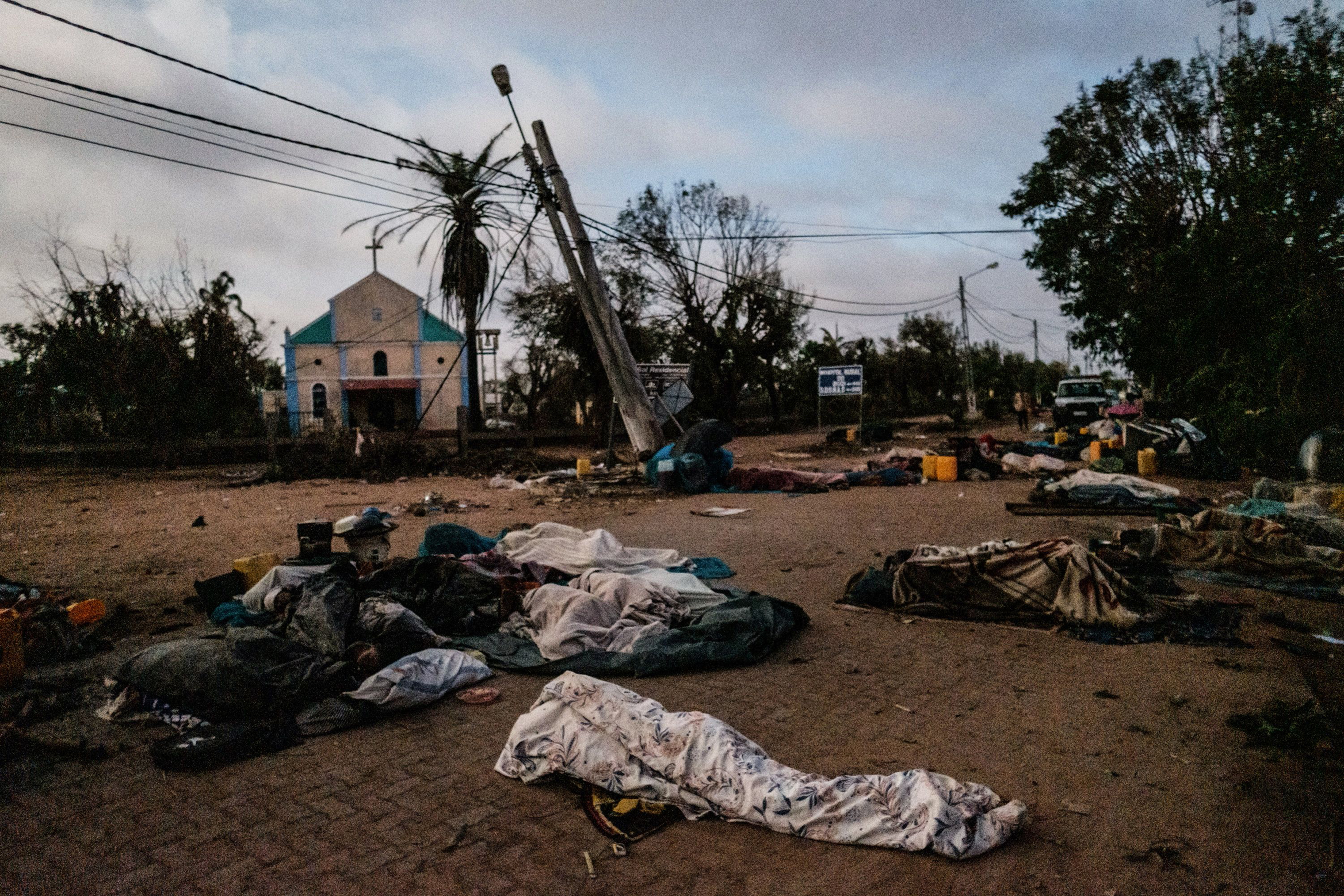People who lost their home after cyclone Idai hit sleep on a street in Buzi, Mozambique, on March 23, 2019.