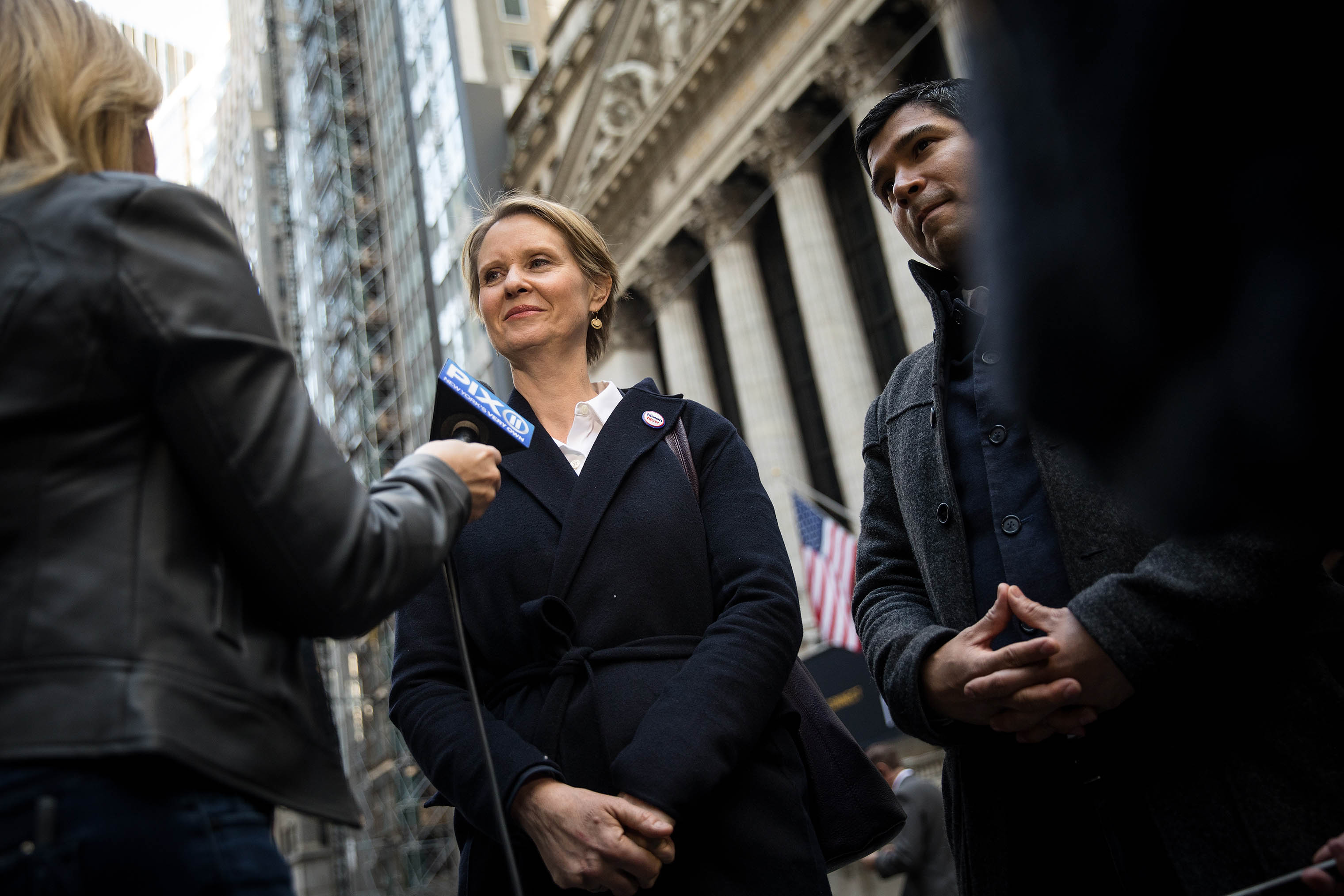 New York gubernatorial candidate Cynthia Nixon speaks with reporters following a rally against financial institutions' support of private prisons and immigrant detention centers near Wall Street on May 1, 2018 in New York City.