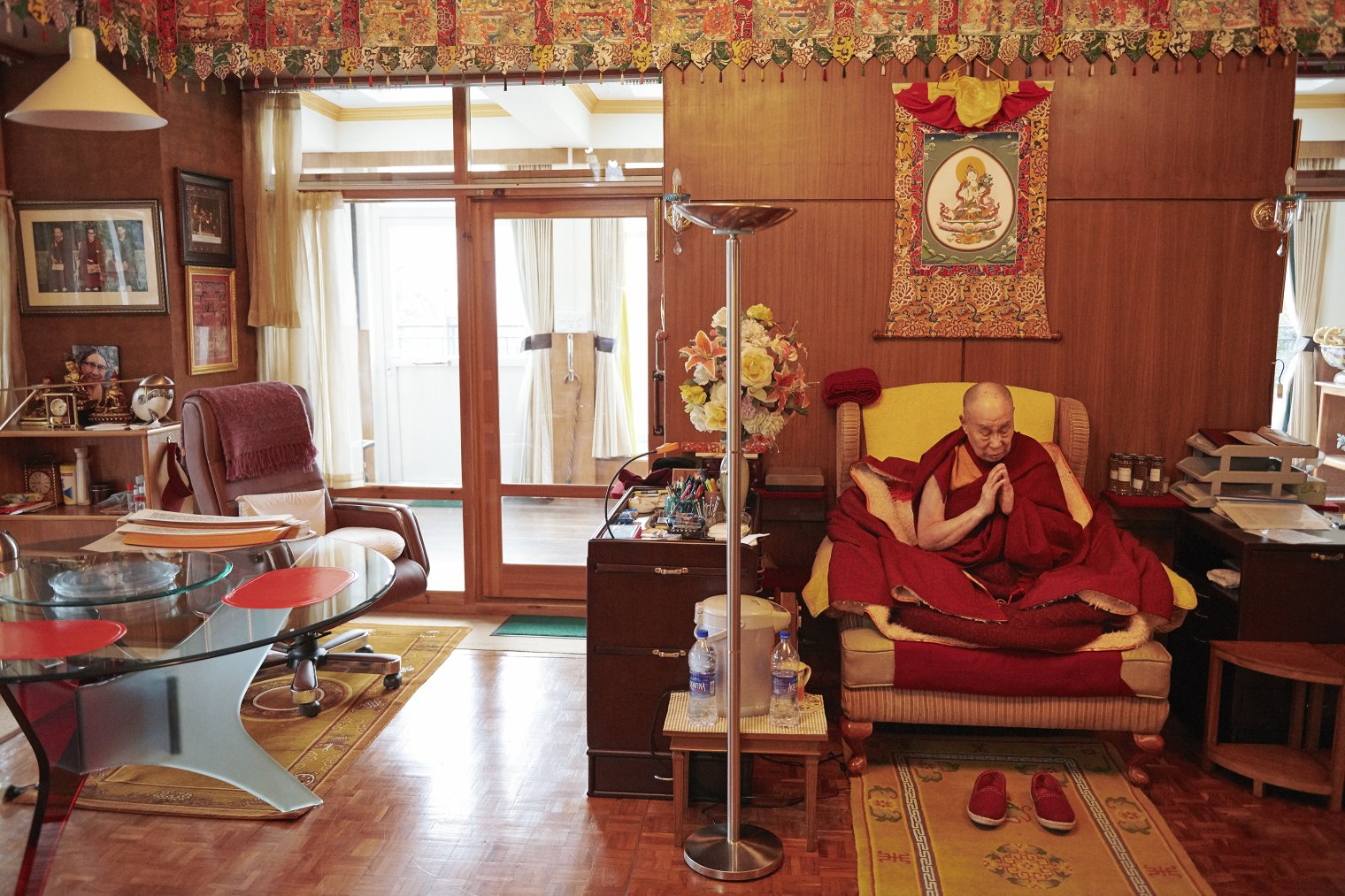 The Dalai Lama meditates in his private chapel inside his residence on Feb. 18.