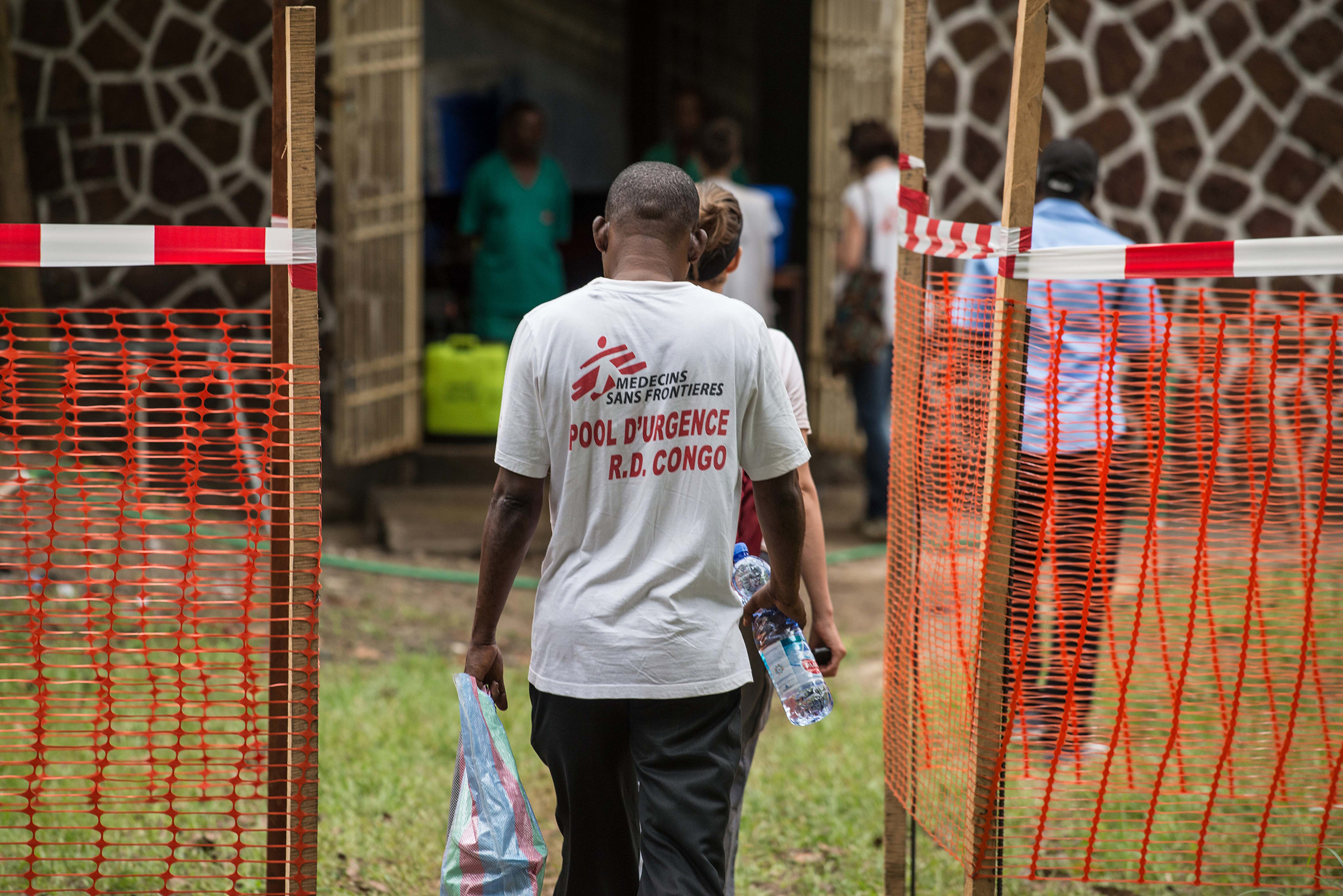 Médecins sans frontière team members walk through an Ebola security zone in Mbandaka, Democratic Republic of Congo, on May 20, 2018