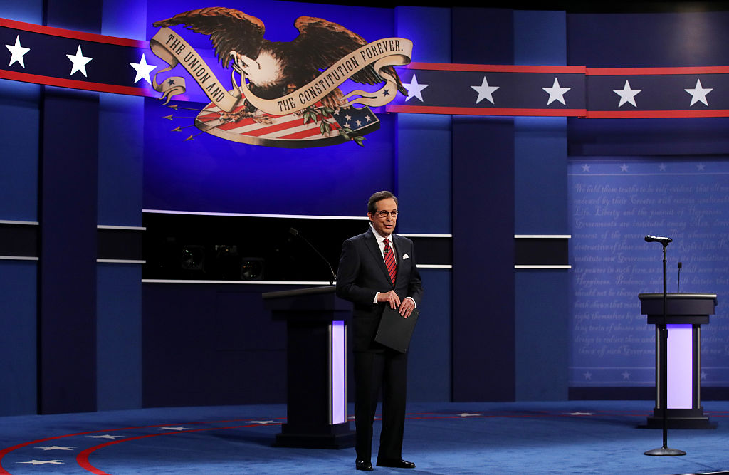 Fox News anchor and moderator Chris Wallace speaks to the guests and attendees during the third U.S. presidential debate at the Thomas & Mack Center on Oct. 19, 2016 in Las Vegas, Nevada. The Democratic National Committee say 'no' to Fox News presidential primary debates on Mar. 6, 2019.