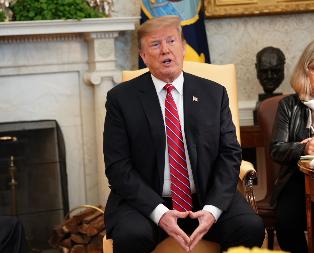 U.S. President Donald Trump speaks during a meeting with Brazilian President Jair Bolsonaro at the White House on March 19, 2019 in Washington, DC. During the meeting President Trump told the press that 'I was never a fan of John McCain and I never will be.'