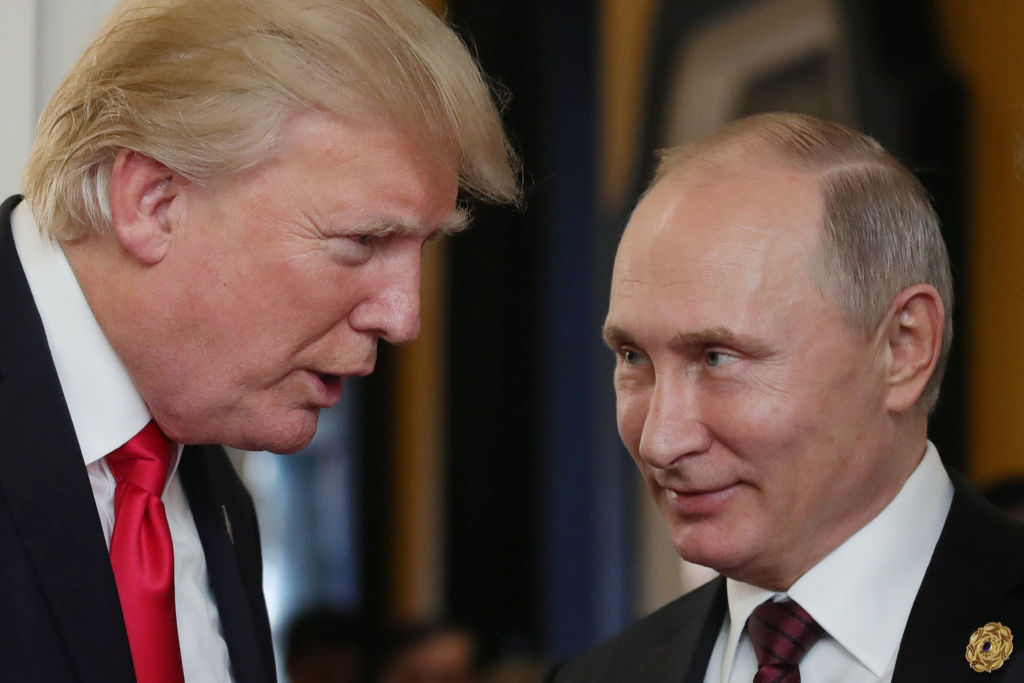 President Donald Trump chats with Russia's President Vladimir Putin as they attend the APEC Economic Leaders' Meeting in the central Vietnamese city of Danang on Nov. 11, 2017.