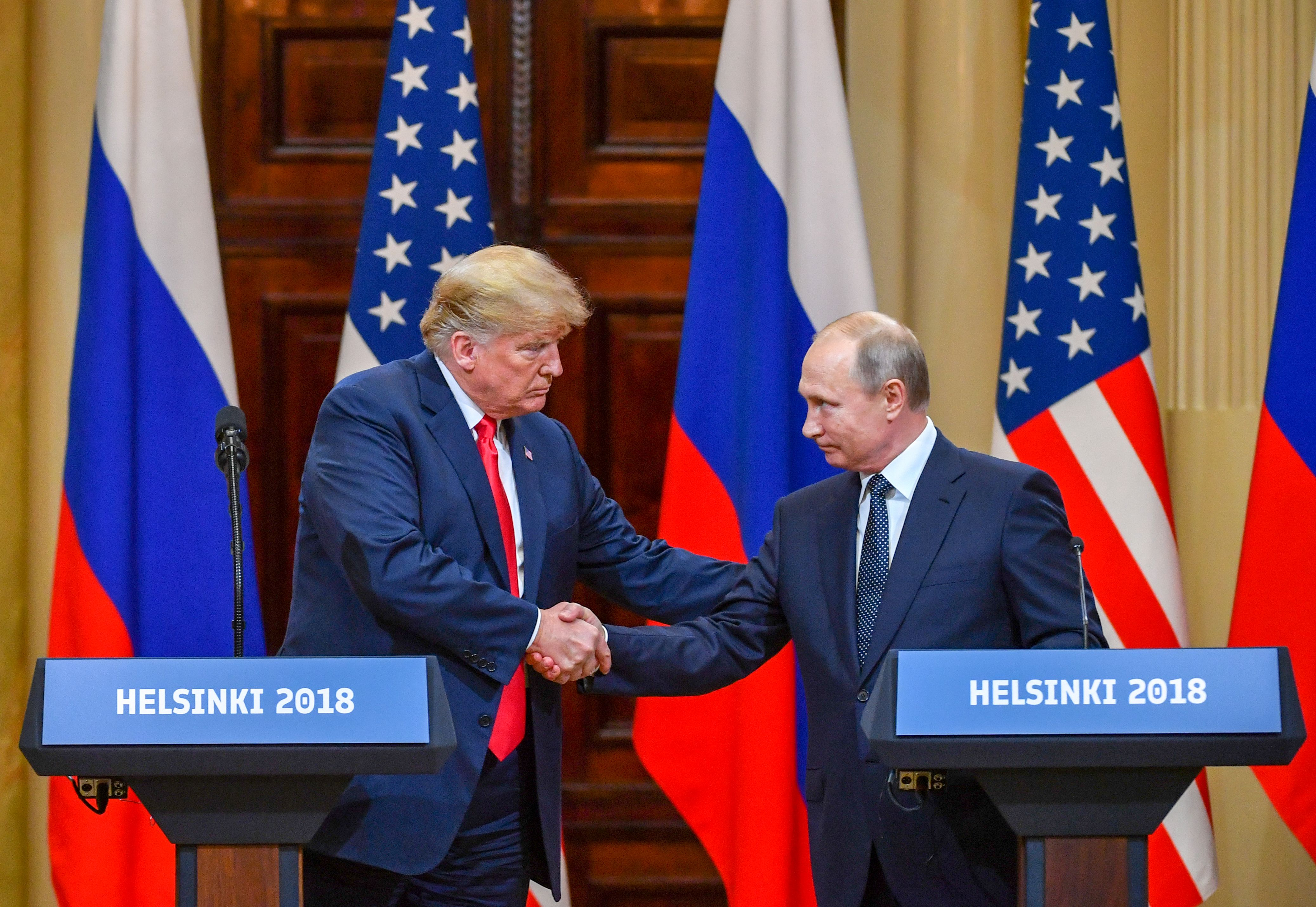President Donald Trump and Russia's President Vladimir Putin shake hands before attending a joint press conference after a meeting at the Presidential Palace in Helsinki, on July 16, 2018.