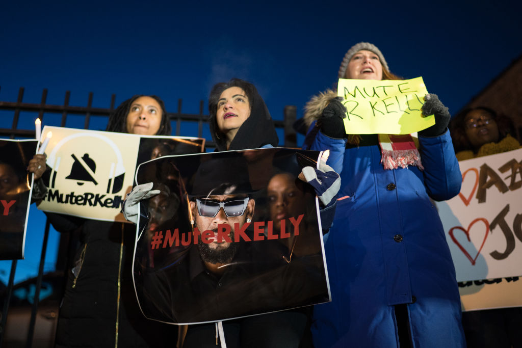 Protestors gather near R. Kelly's former recording studio in Chicago on Jan. 9, 2019 following the release of a Lifetime docuseries 'Surviving R. Kelly' which highlighted years of sexual abuse against young women.