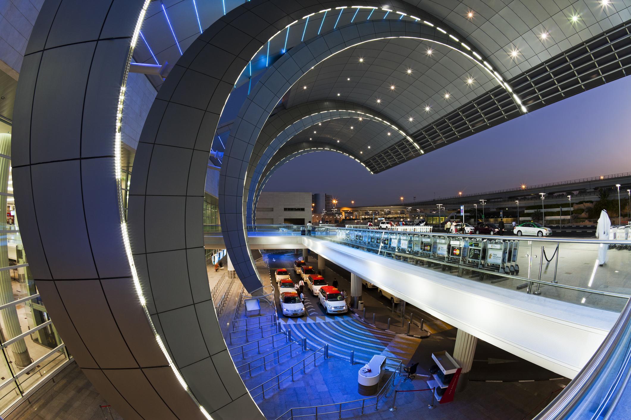 Modern architecture of Terminal 3 at Dubai International Airport, Dubai, UAE.