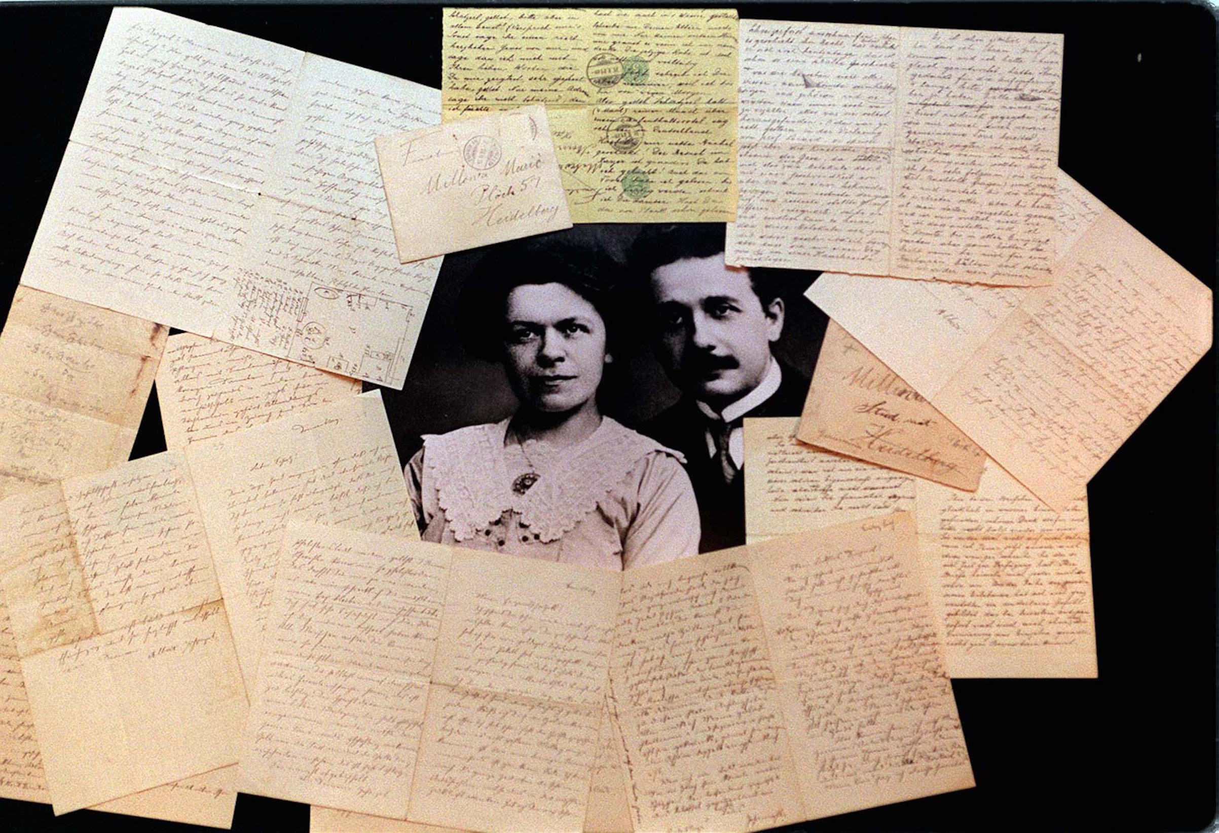 Einstein Family Correspondence, including Albert Einstein-Mileva Marie love letters, surround a portrait of the couple, before going under the hammer at Christie's in New York on November 25, 1996.