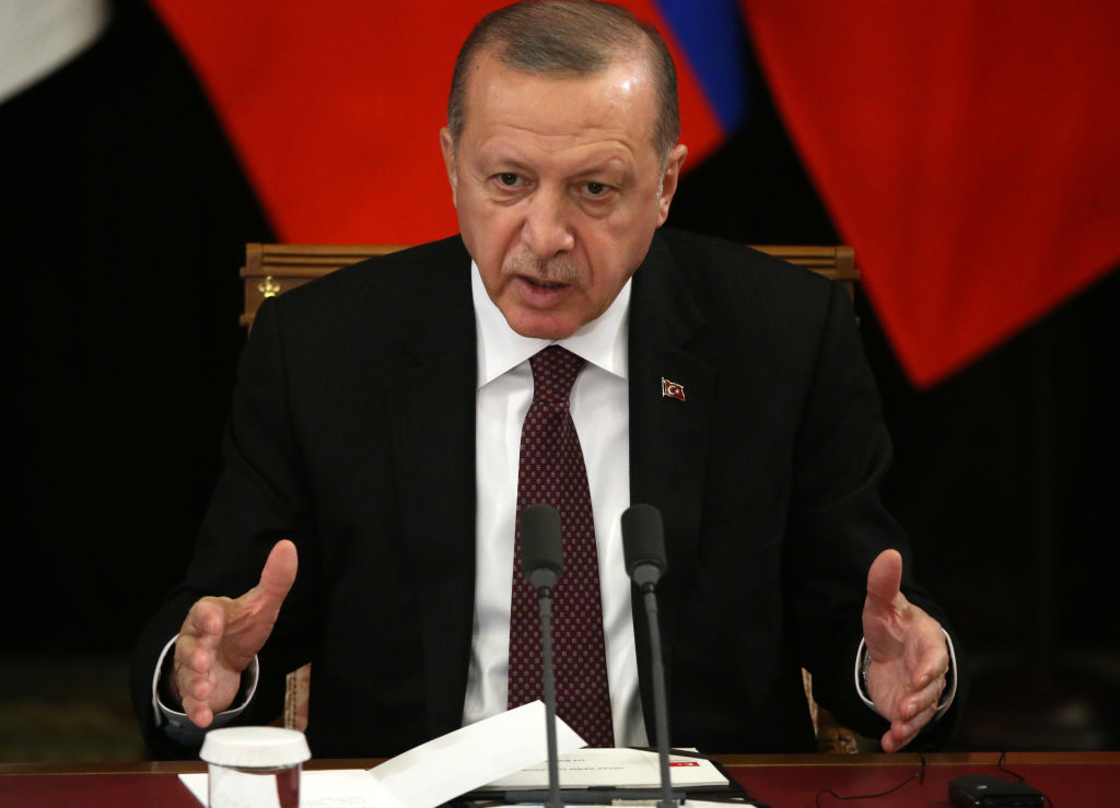 Turkish President Recep Tayyip Erdogan speaks during a Russian-Turkish-Iraninan meeting in Sochi, Russia, February 14, 2019.